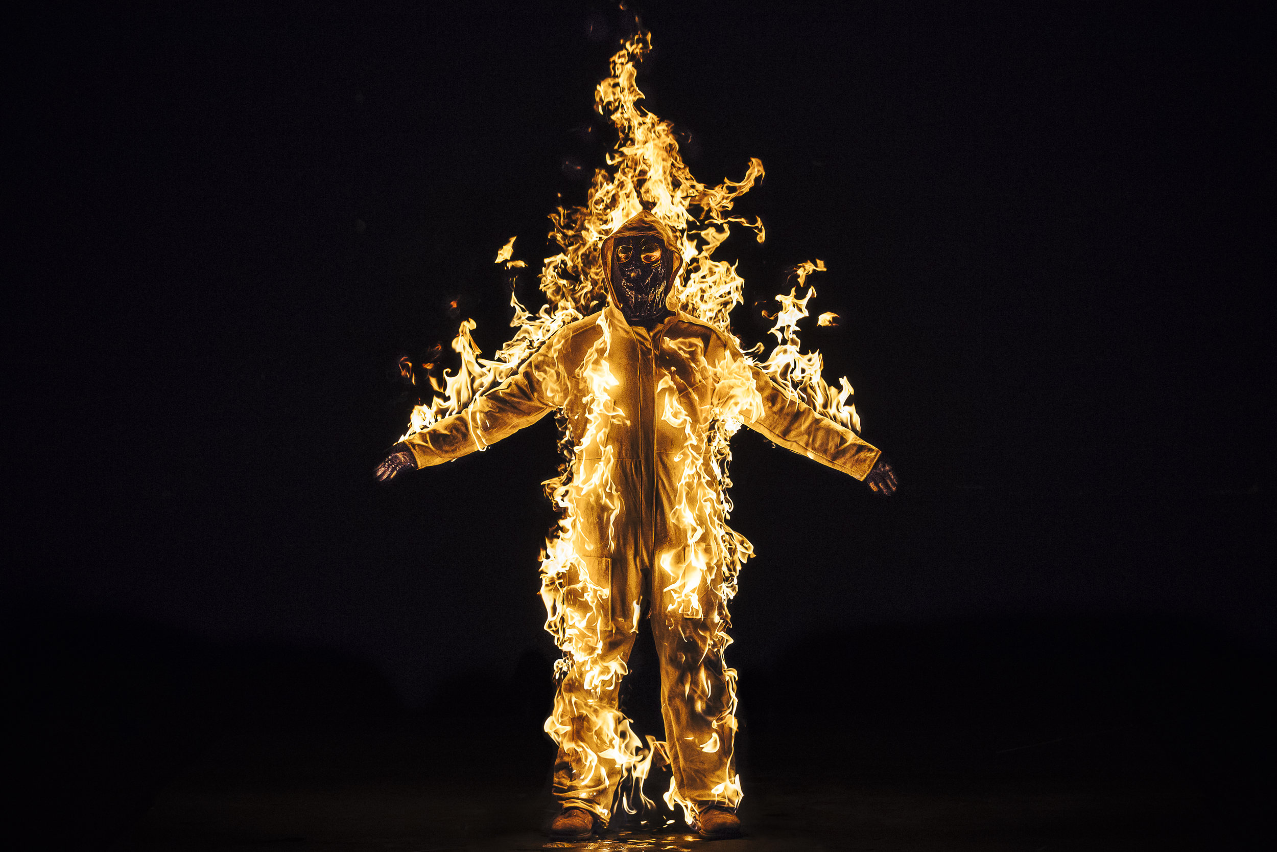 Cassils is lit on fire during their performance  Inextinguishable Fire , performed on Nov 8, 2015 at the National Theatre in London as part of SPILL Festival of Performance. Photo credit: Cassils with Guido Mencari © Cassils 2015 Image courtesy of the artist and Ronald Feldman Fine Arts