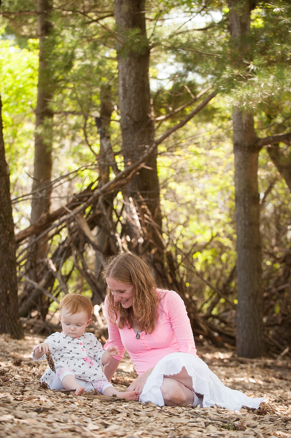 Elko New Market Family Photographer Anthologie specializes in capturing candid moments with you and your family. Mother and daughter photographed at White Tail Woods Park in Rosemount, MN.