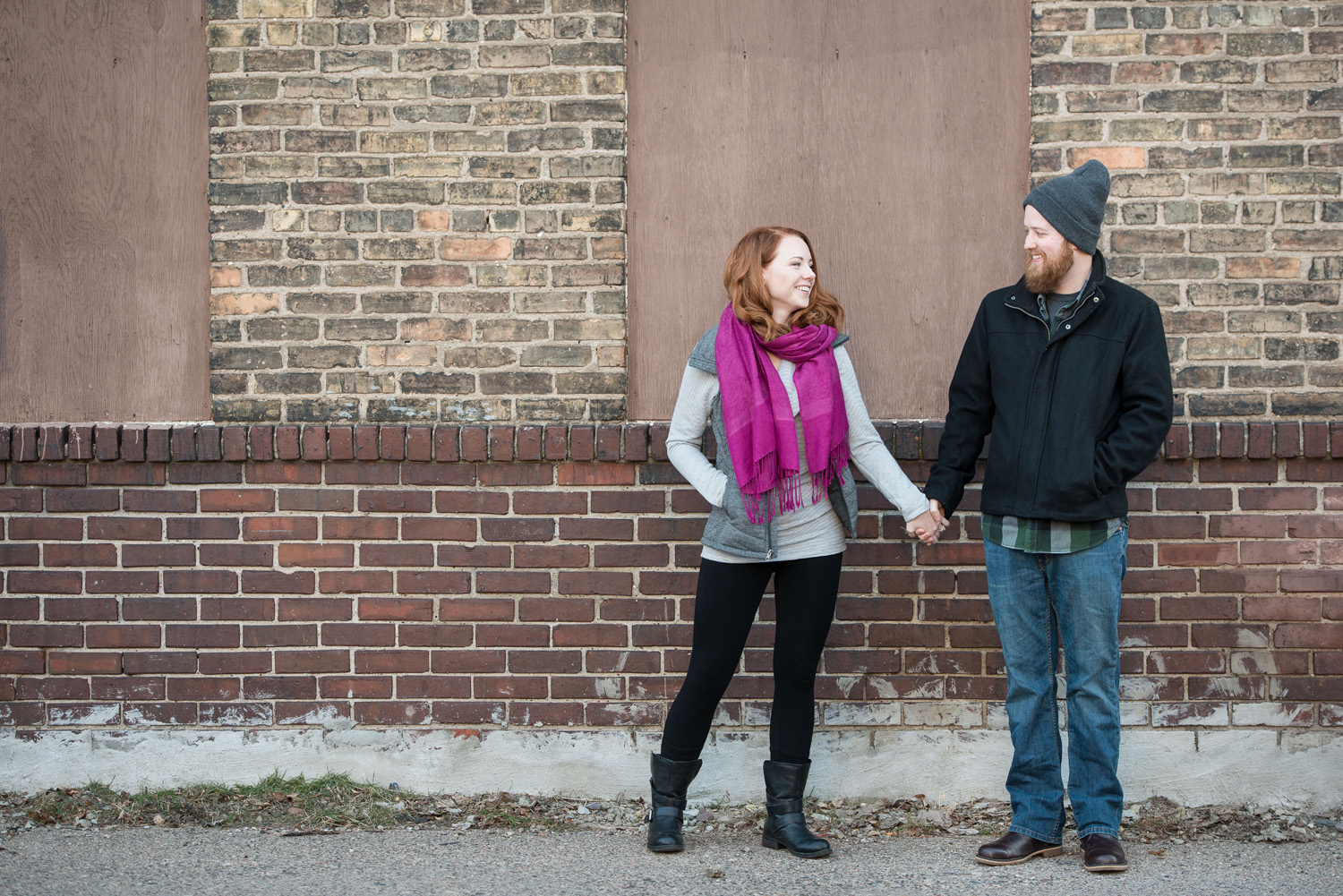 nicole and patrick outside indeed brewing company in minneapolis