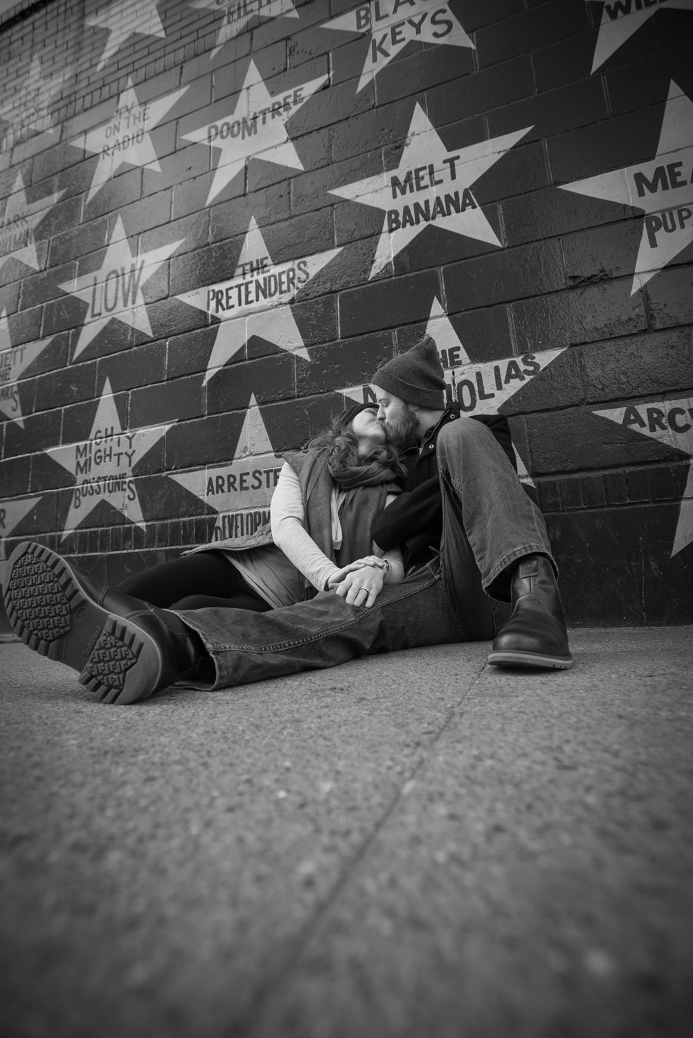 Nicole and Patrick share a kiss outside First Avenue during their minneapolis engagement photo session