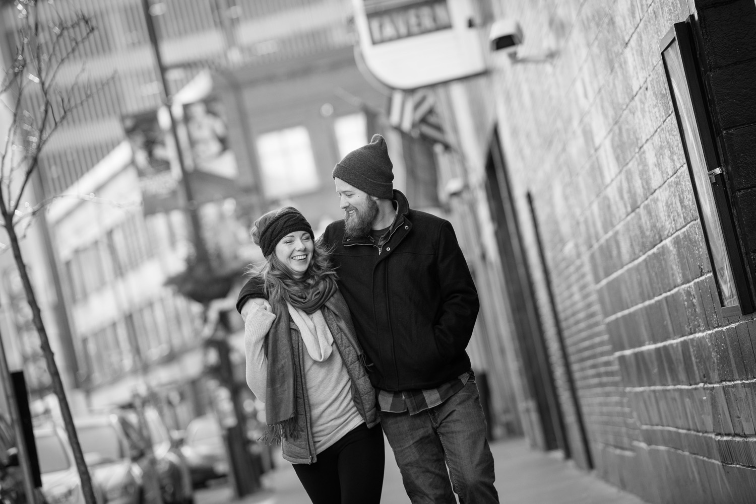 Nicole and Patrick enjoy each other's company as they walk down Seventh Street during their Minneapolis engagement photo session