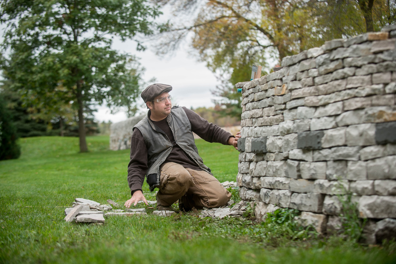Daniel Arabella, of Arabella Stone Co. feels for the necessary stone that will find its new home nestled in a beautiful drystone wall at The Gardens of Castle Rock. Daniel efficiently works his craft by using his sense of touch rather than his vision to discover the missing puzzle pieces. Some times they need to be slightly shaped, other times, they are a perfect match.