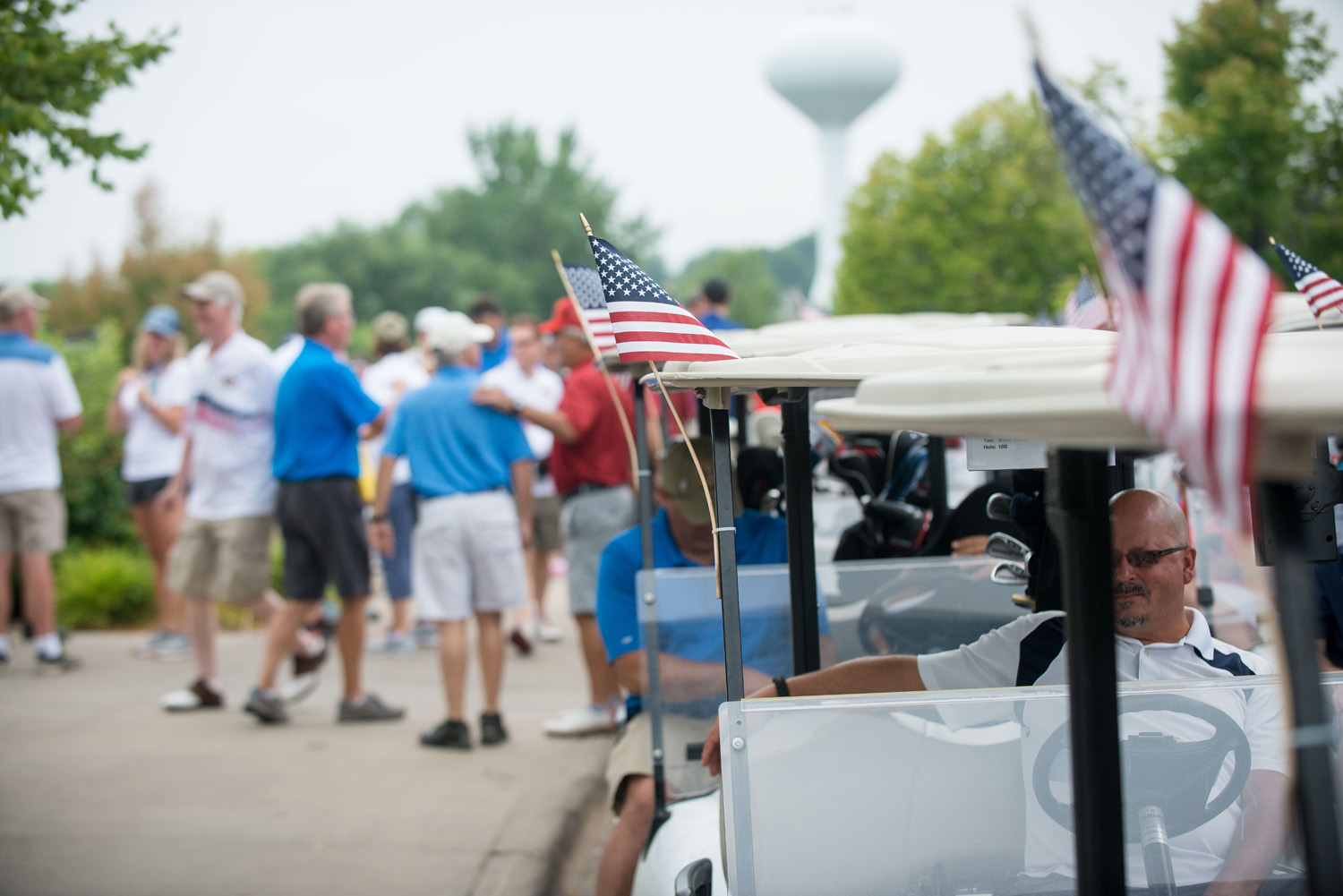 American flags adorn golf carts as the Eagle Heroes Golf Tournament gets underway at Crystal Lake Golf Club in Lakeville, MN. Photo by Lakeville Golf Tournament photographer Anthologie.