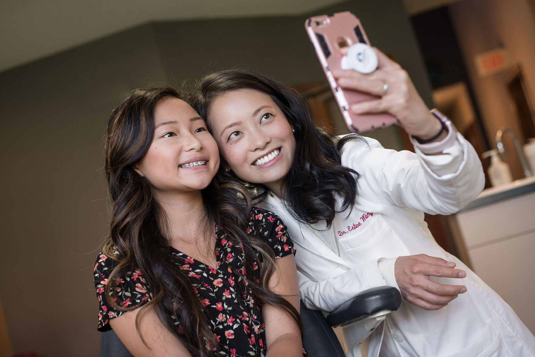 "Dr. Estee Wang grabs a selfie with one of her patients for her ""borntosmile"" hashtag while working at her practice in Maplewood, Minn. I chose this photo as it illustrates Dr. Wang's own philosophy of showcasing her personality in the workplace as well as my own. This image presented itself in between more staged photos. I think had I not went into the assignment thinking as a photojournalist instead of a commercial photographer only I would have missed the opportunity for a great photo."