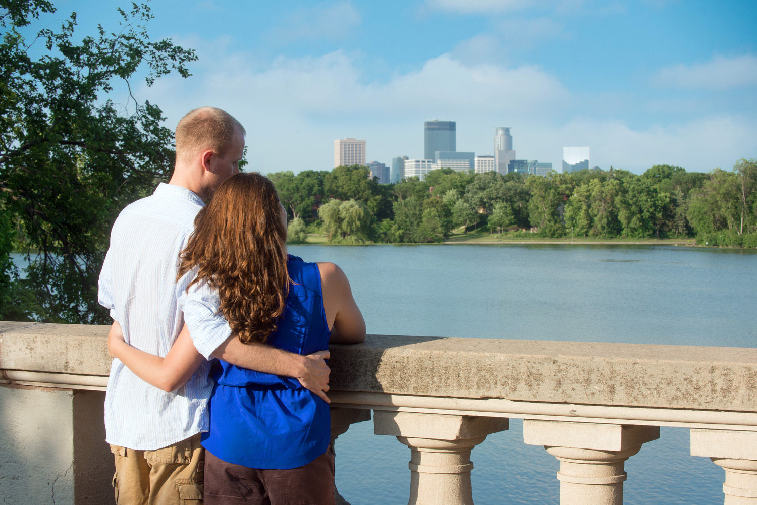 A Twin Cities couple takes in the view of the Minneapolis skyline from the Kenwood Neighborhood.