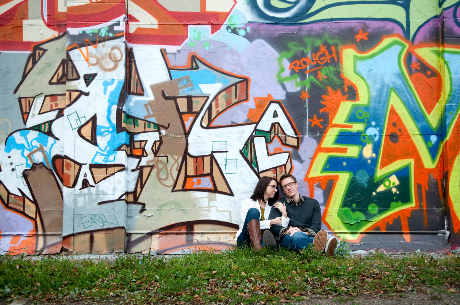 A couple posing for portraits near one of the graffiti-decorated walls at the Intermedia Arts Building in Uptown Minneapolis.