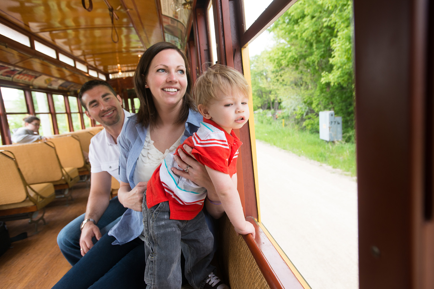 A family takes in the sights from the vantage point of the Como-Harriet Streetcar line in Southwest Minneapolis.