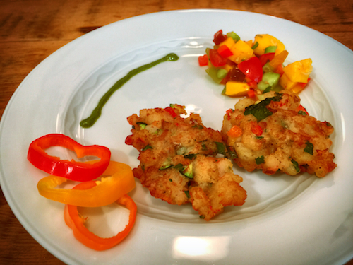 Image: Saltfish cakes with mango cucumber tomato salad. Prepared by the author. Photo by Claudio Napoli.