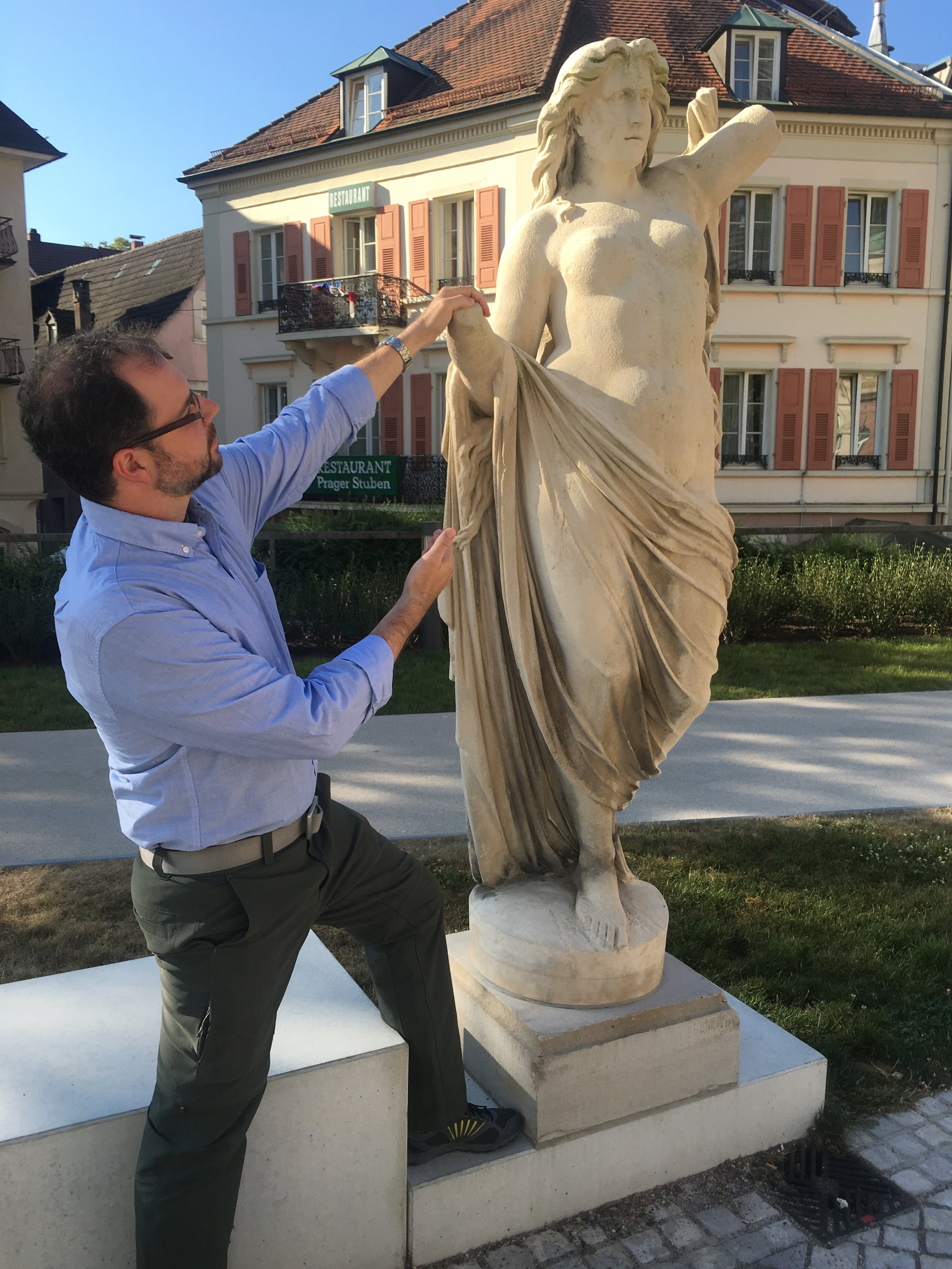 "Micah beholding the beauty of a Roman goddess outside the Irish-Roman thermal baths in Baden Baden Germany. The baths impose a strict ""No textiles"" rule."