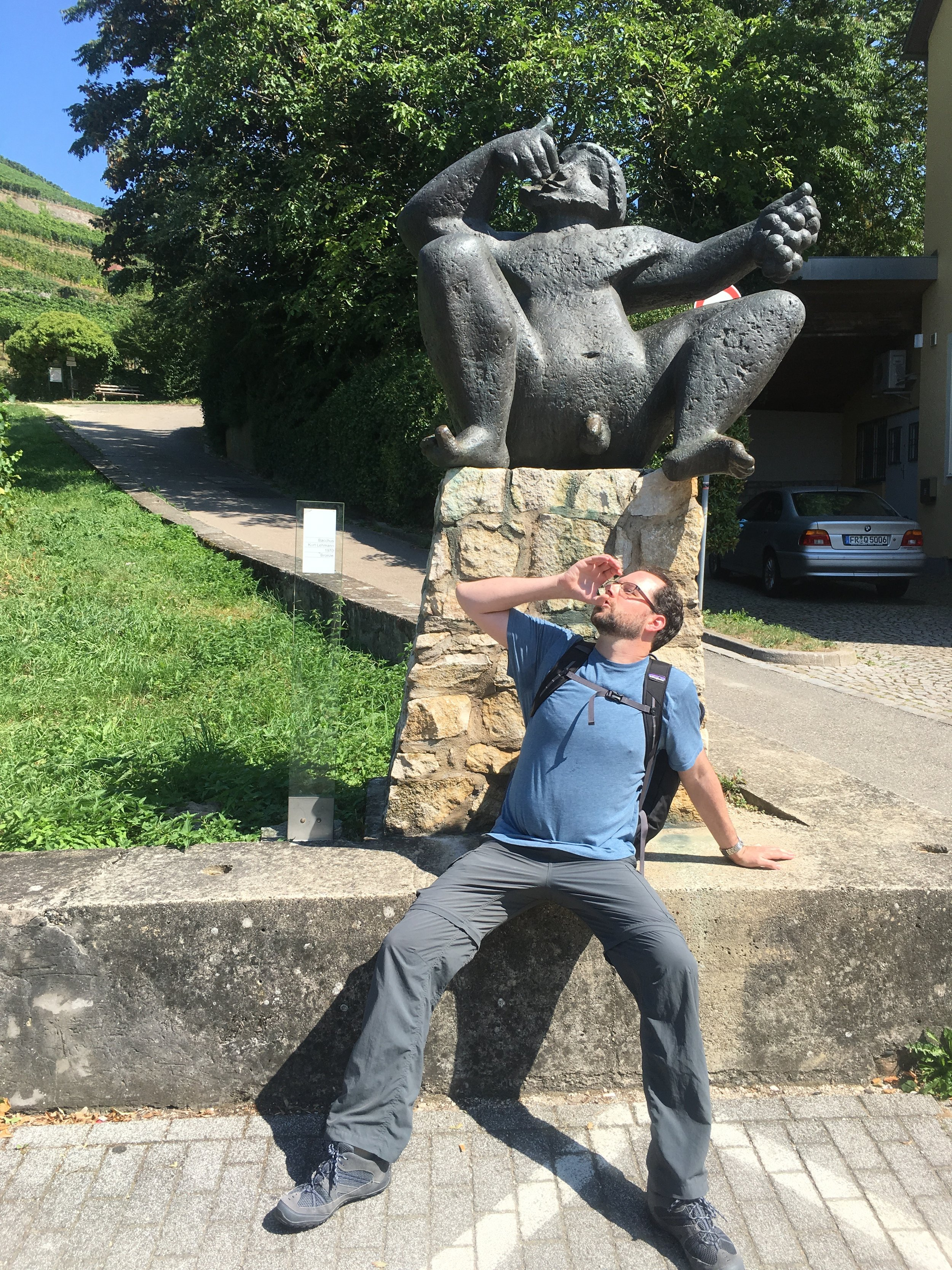 Micah in front of a statue of a rather happy (possibly drunk) Bacchus--the Roman god of wine--in the small, picturesque village of Staufen, Germany. He makes nudity look easy!