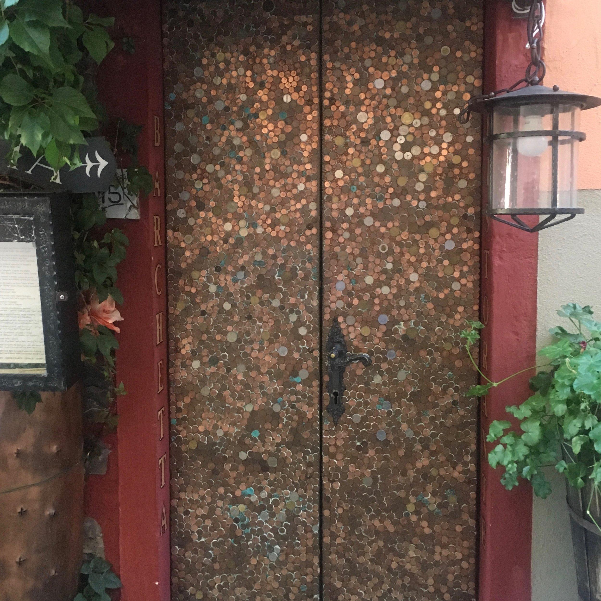 A door made of money in Bellagio, Italy