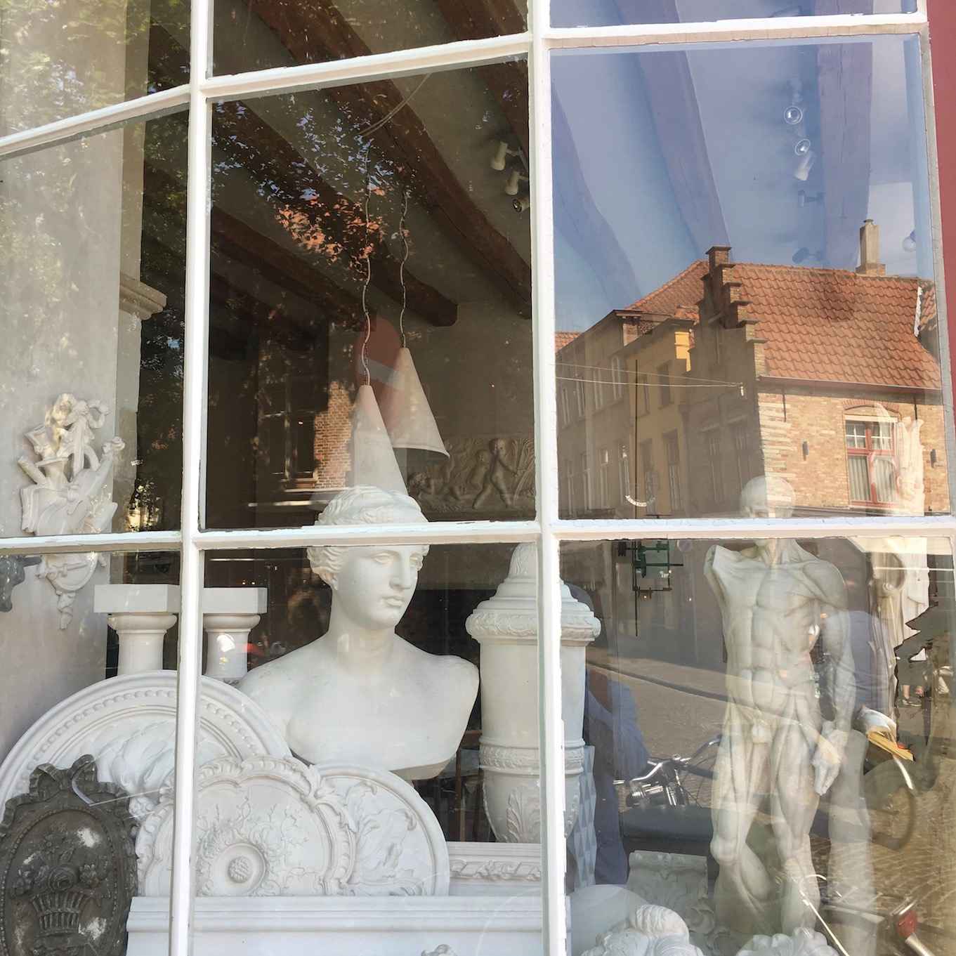 I missed an opportunity to go back and visit the inside of this artist's shop in Bruges, Belgium. What a pity.