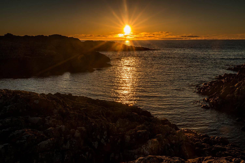 Awaiting the right light on the rocks, Balevullin.
