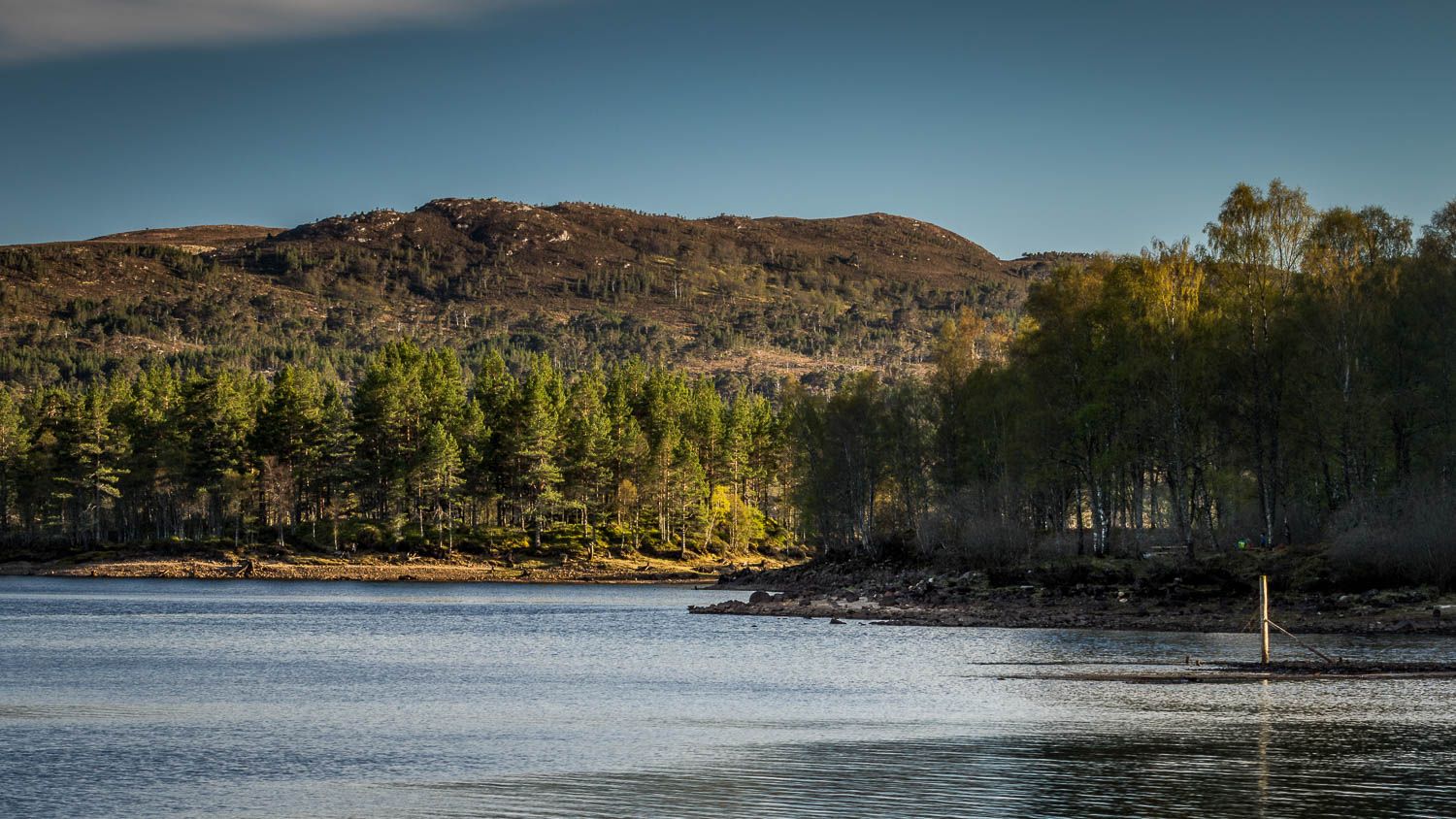 The fading sunlight from the shores of Loch Beinn A' Mheadhoin.