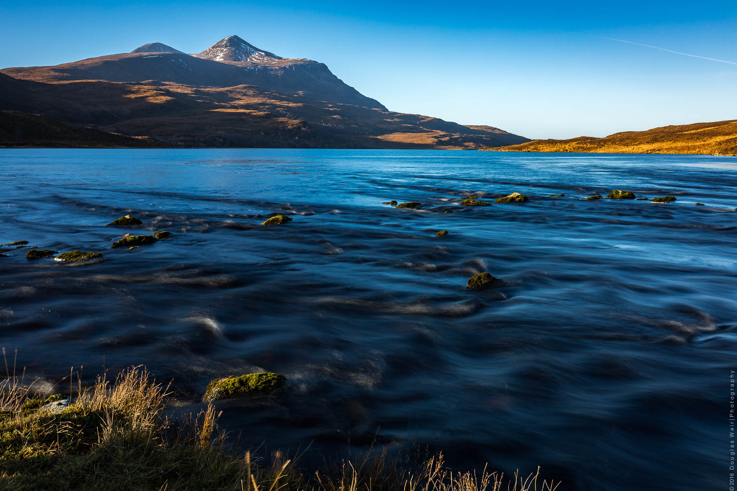 Fionn Loch and Cul Mhor in mid-morning light.