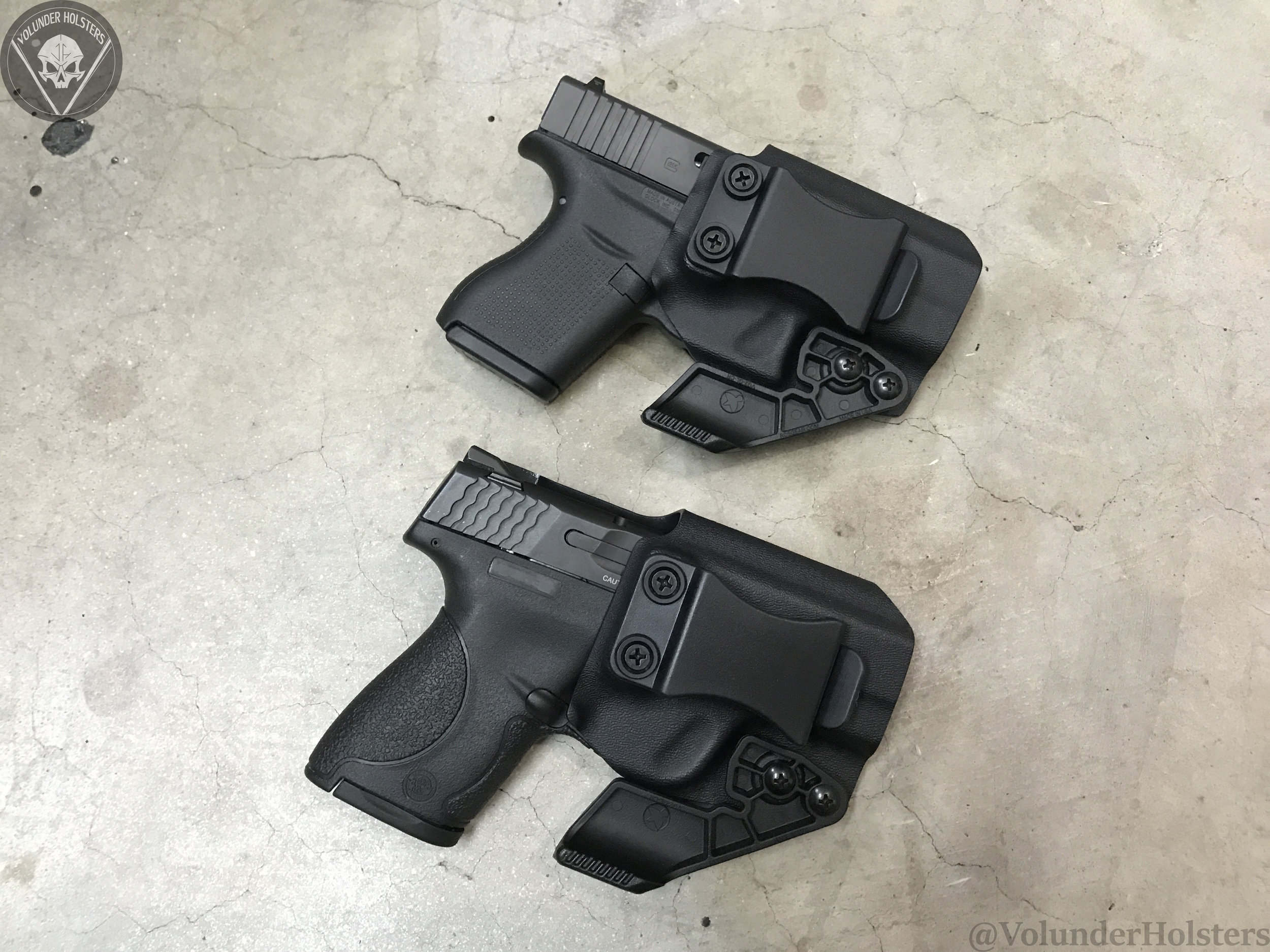 Garm with Claw G43 and M&P Shield v2 cement.jpg