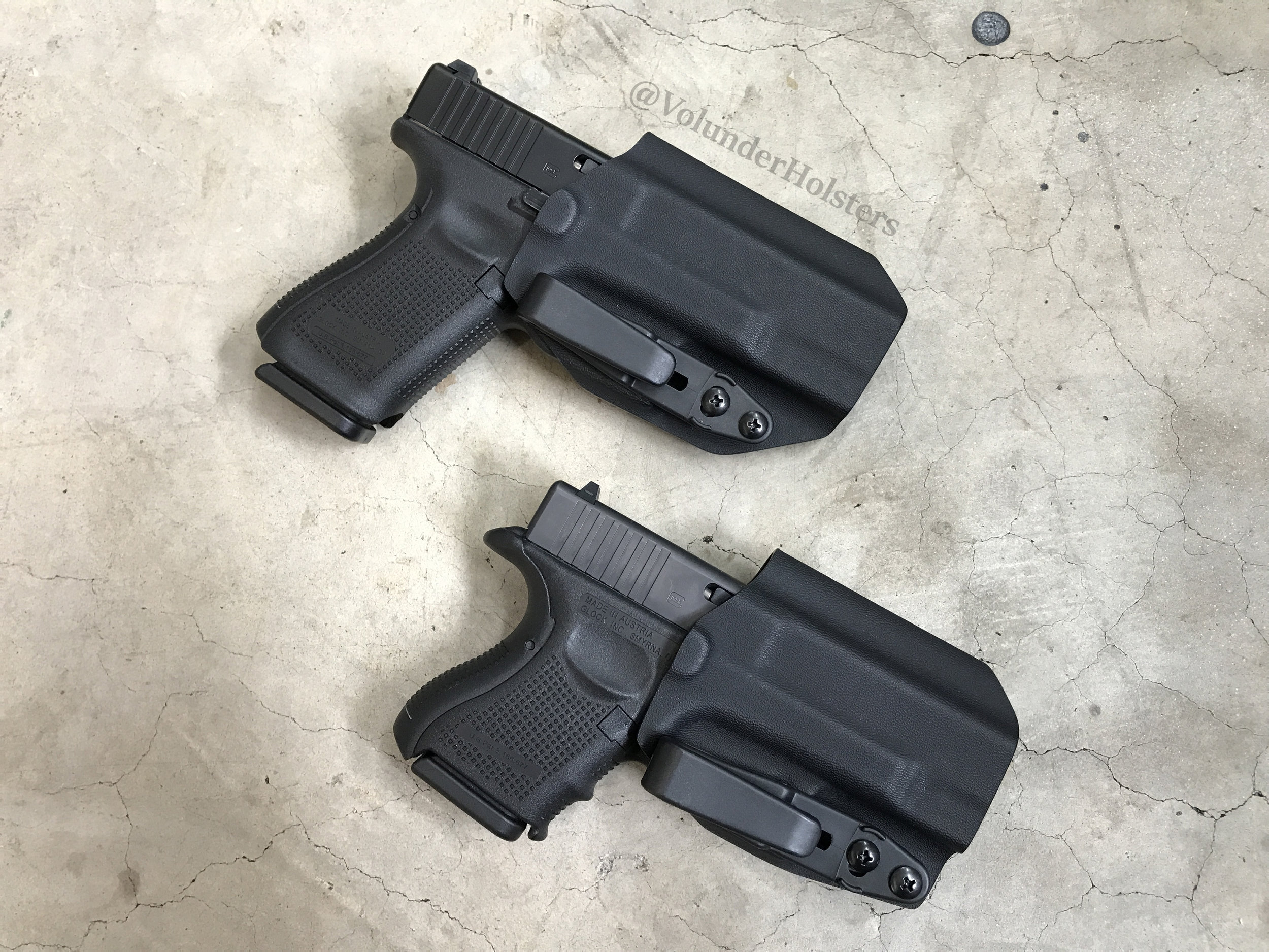 New Group Orthrus Glock 19 and G26 on cement v1.jpg