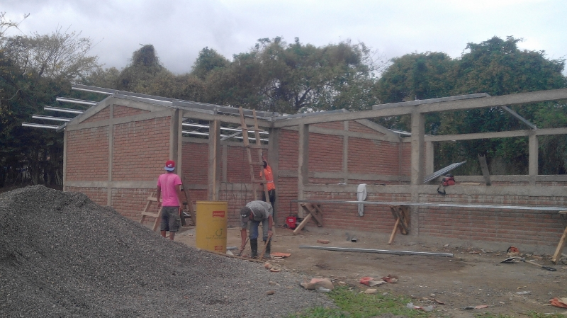 Installing the roof on the new classroom building