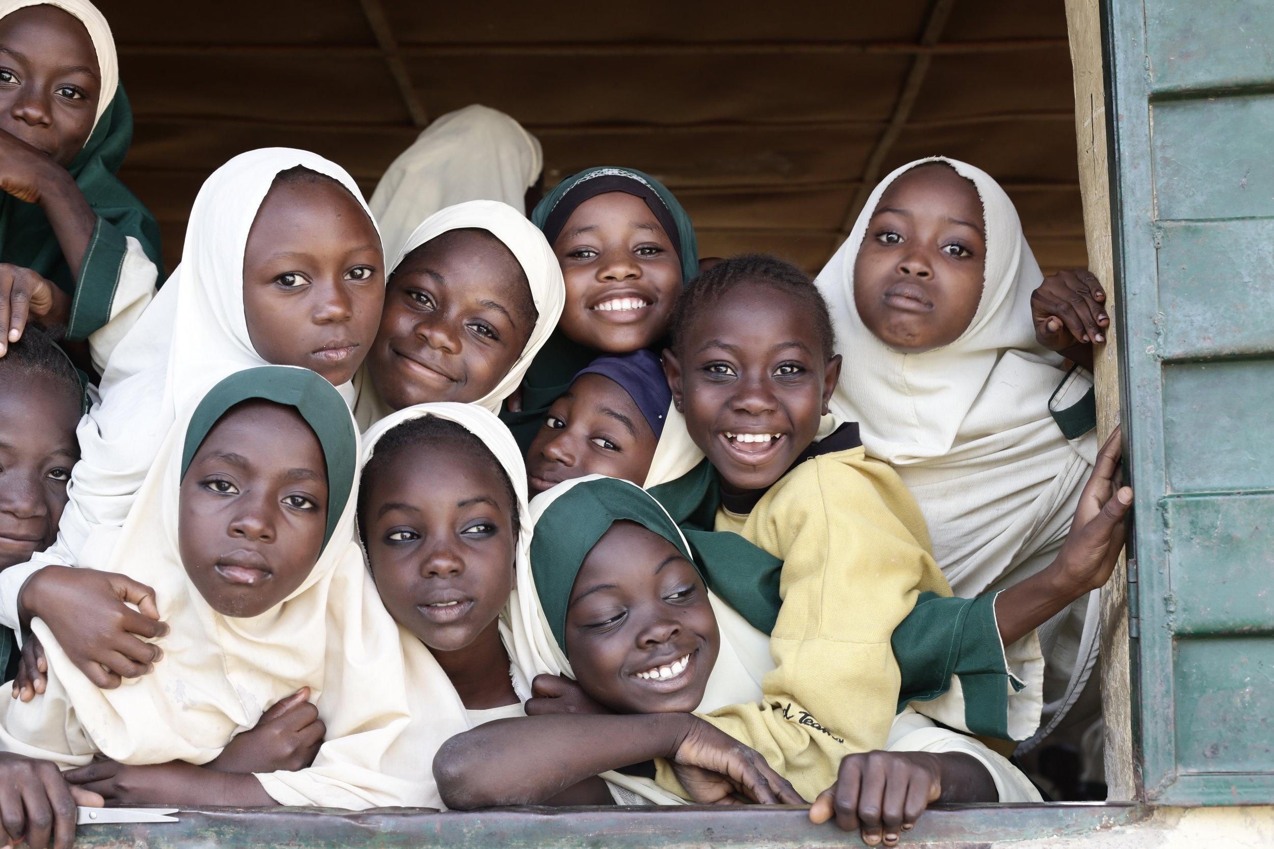 IMG_2910_window full of smiling girls.jpg