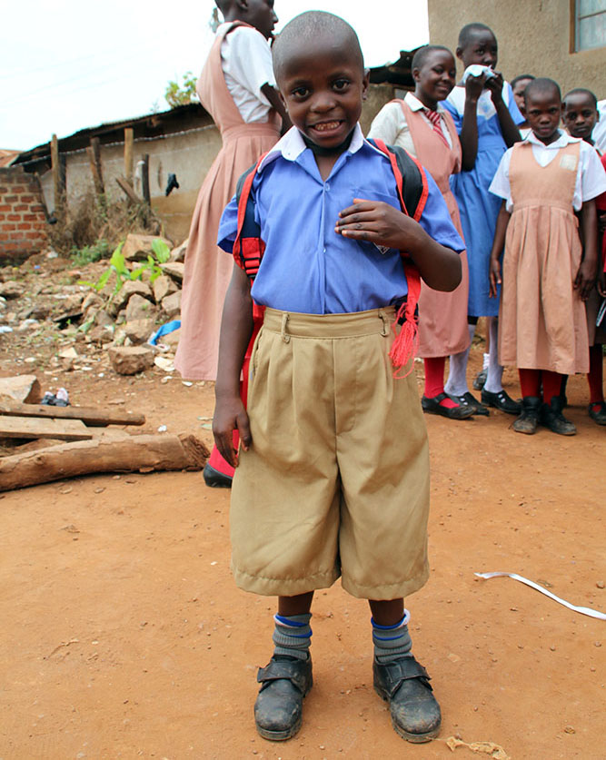 Brian in his new uniform on his first day at school. Will he ever grow into those shorts!