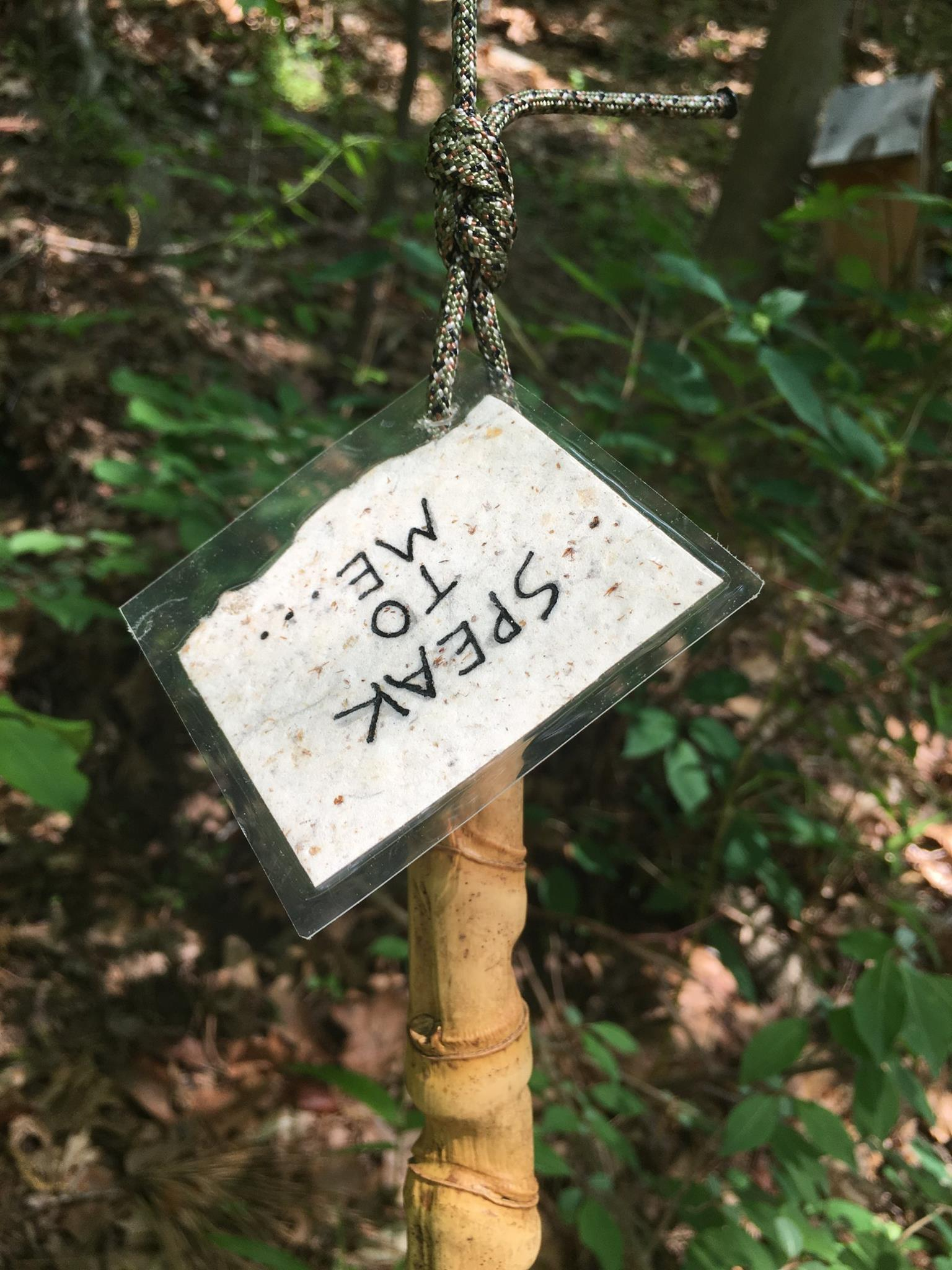 """Attached to the clapper is a label that reads """"Speak to me..."""" on one side and """"gently"""" on the other.Visitors at Blue Heron Nature Preserve in Atlanta, GA are invited to interact with the   Mother Tongue  , using the bamboo clapper to activate the chime."""