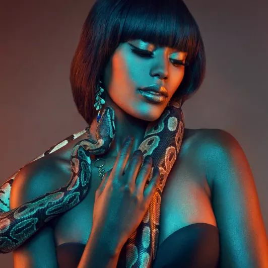 """Craziest shoot? """" The shoot that I did with Squiggles the Snake, Model Anita Mwiruki, and photographer Sennia Kyle."""""""
