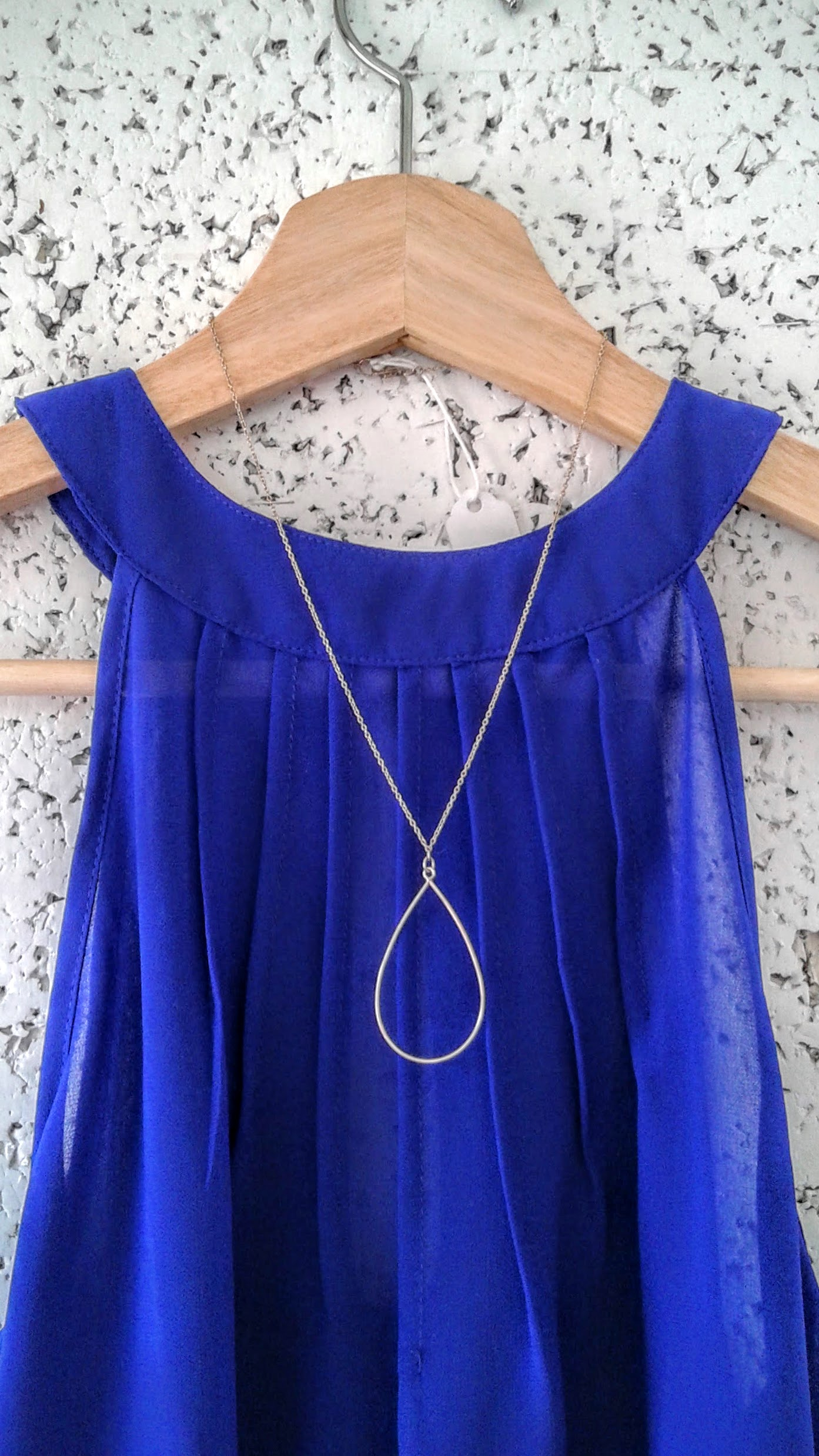 Hilary Druxman necklace, $18; Lola top, Size S, $16