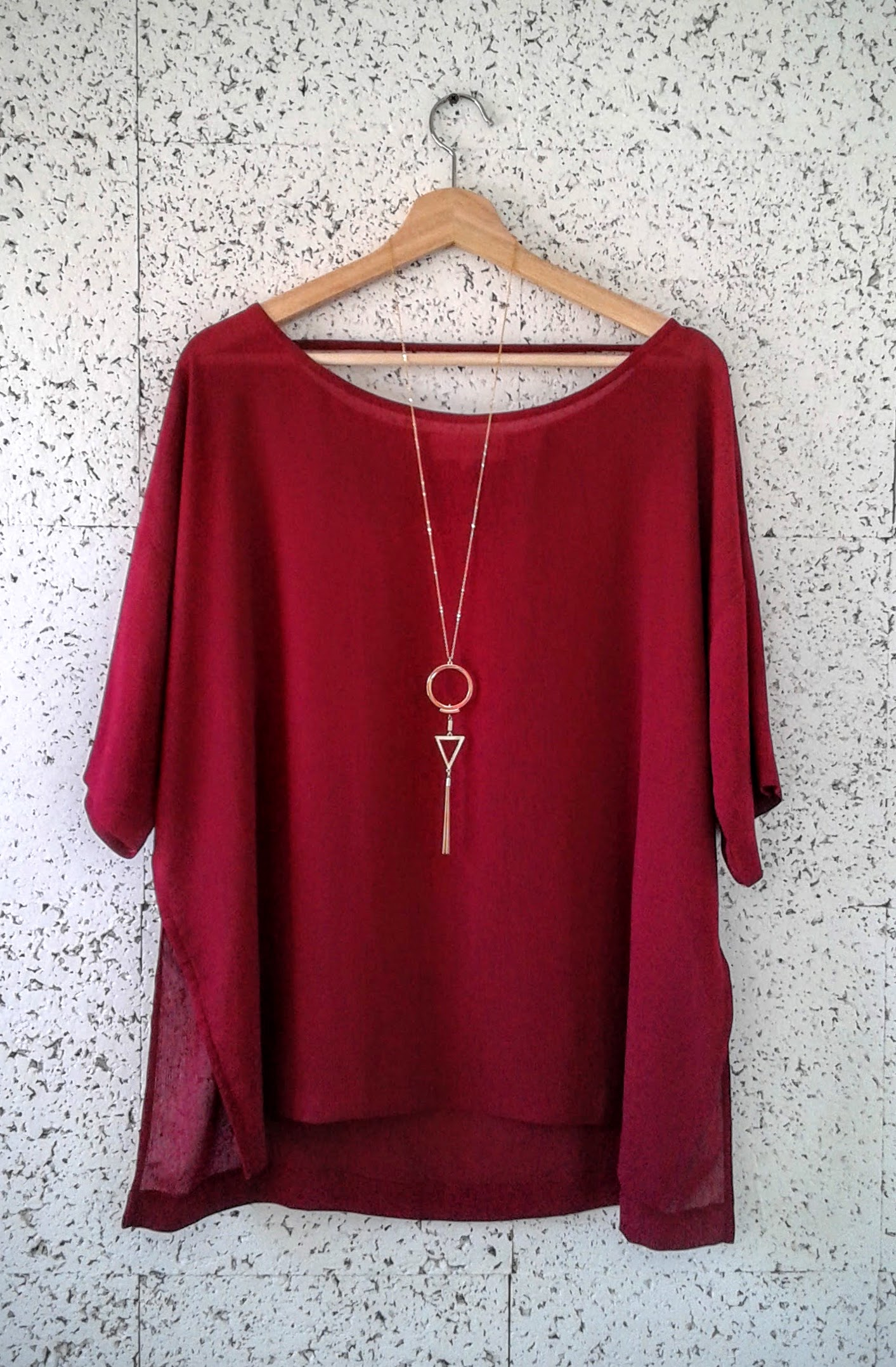 Nicole Campre top; Size M, $26; Necklace, $14.