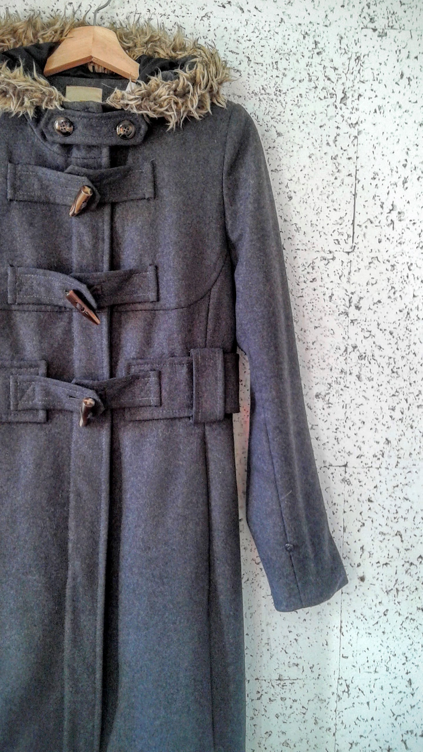 (Who was looking closely? This coat was peeking out from the backroom last week!)