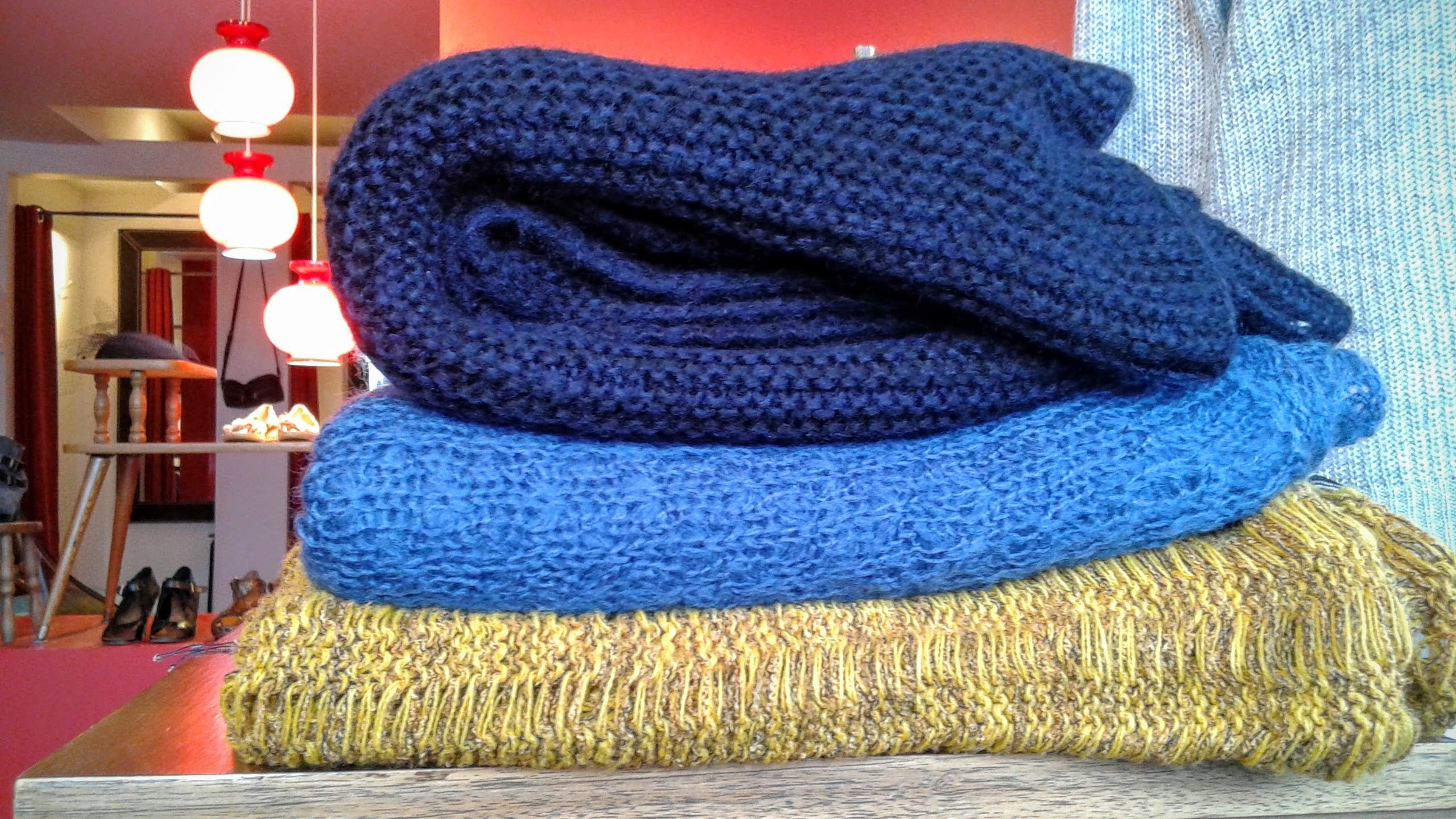Black Zara scarf, $22; blue Delux infinity scarf, $20; yellow buttoned scarf, $28
