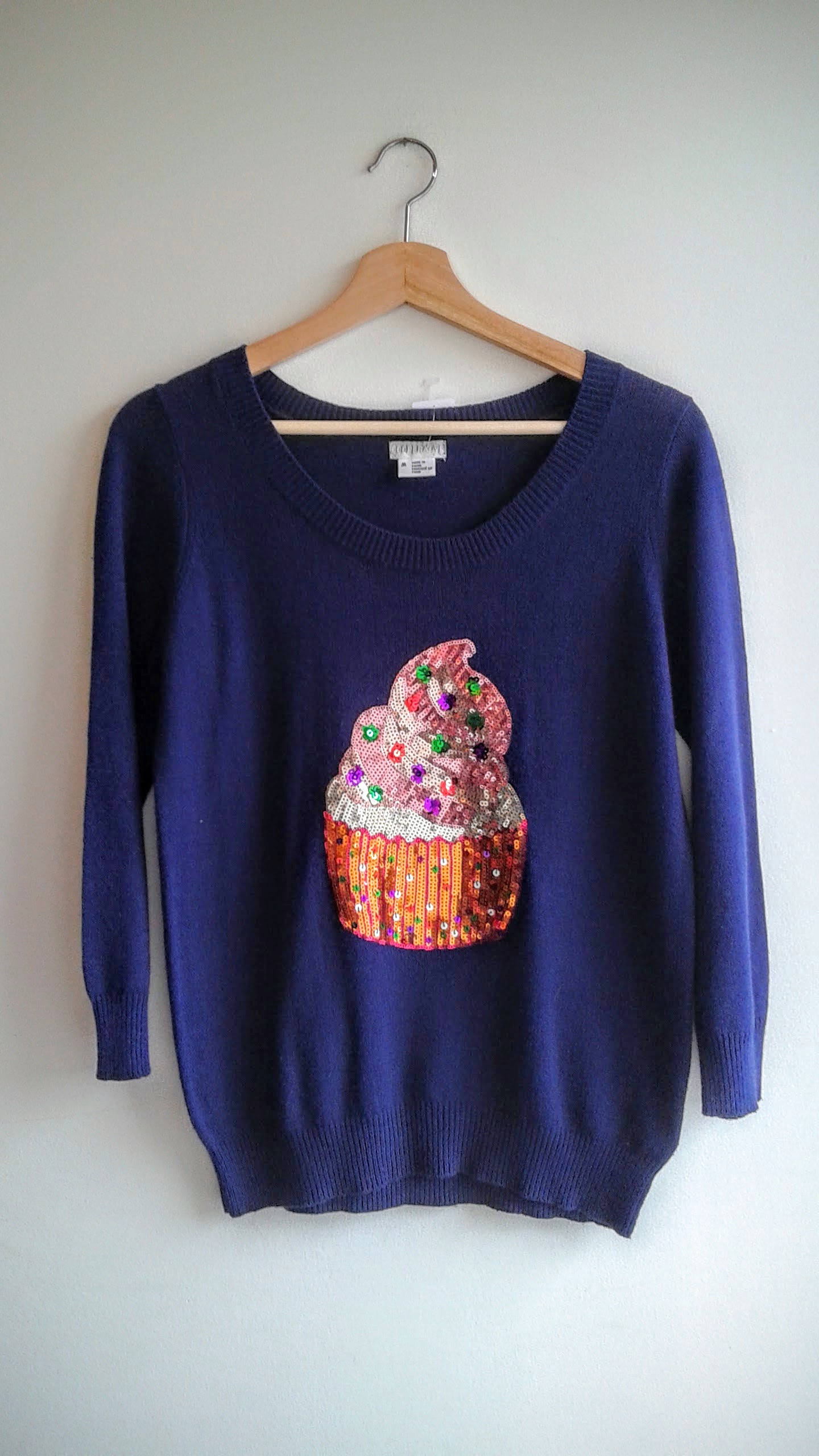 Cooperative sweater; Size M, $28