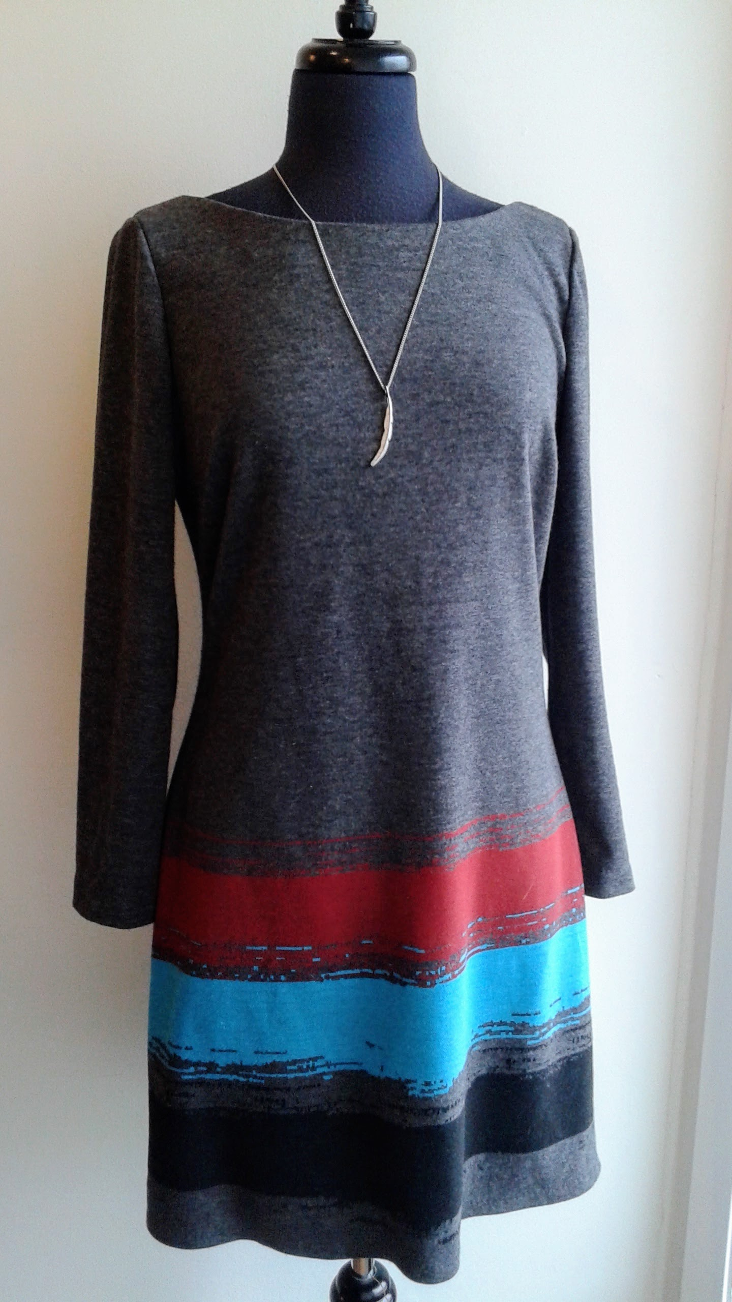 Tracy Reese dress; Size M, $42. Feather necklace, $14