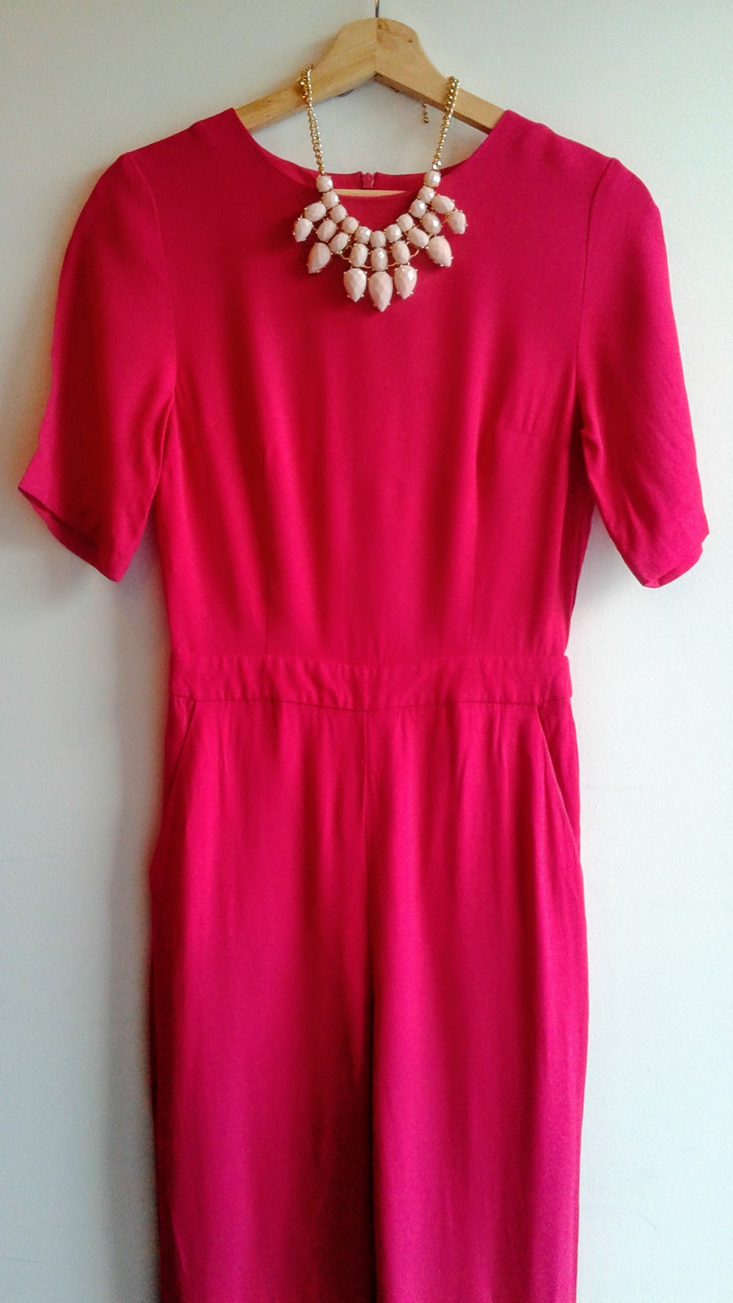 Topshop jumpsuit; Size S, $46. Necklace, $28