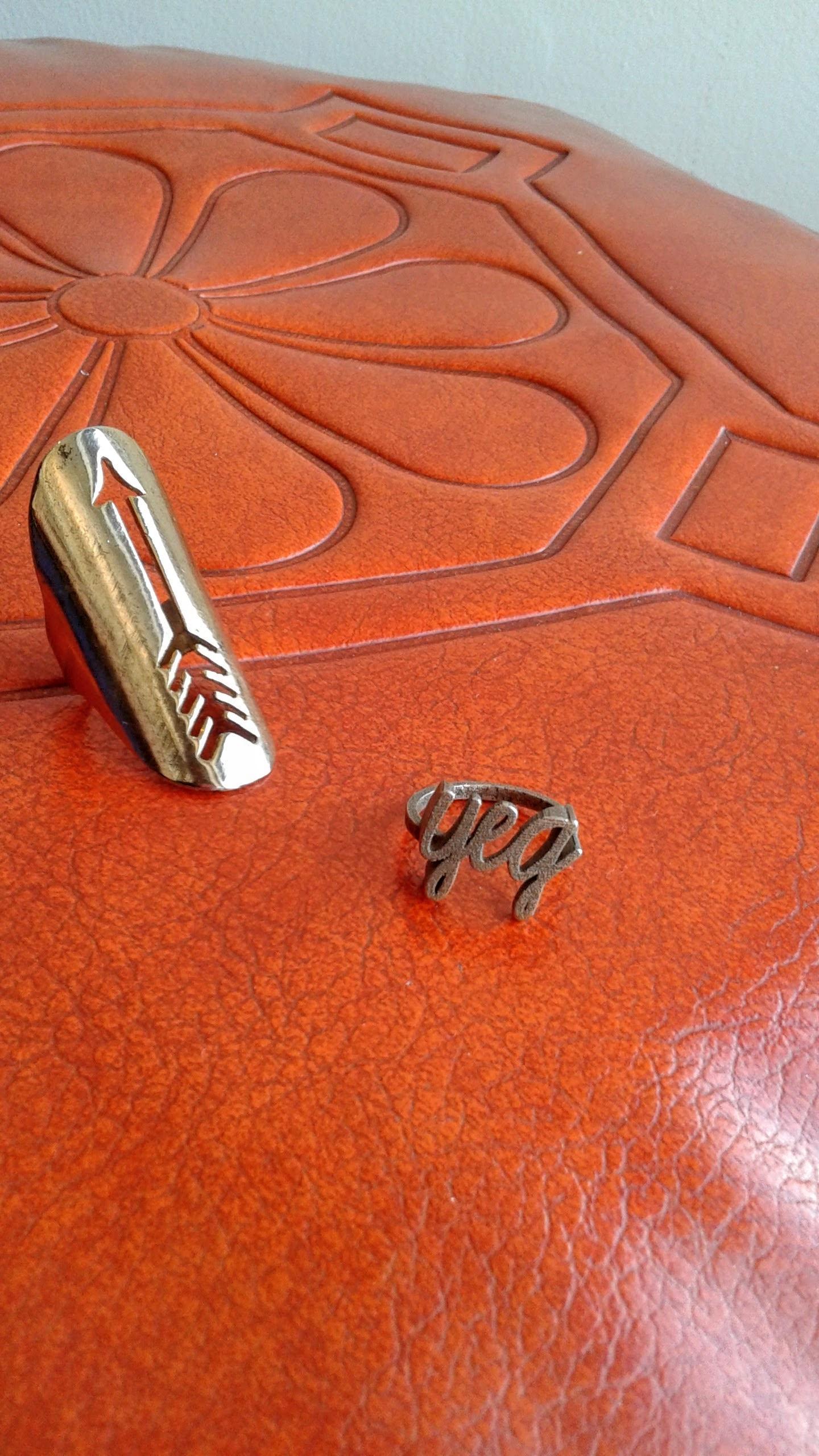 Arrow ring. $12; YEG ring, $12