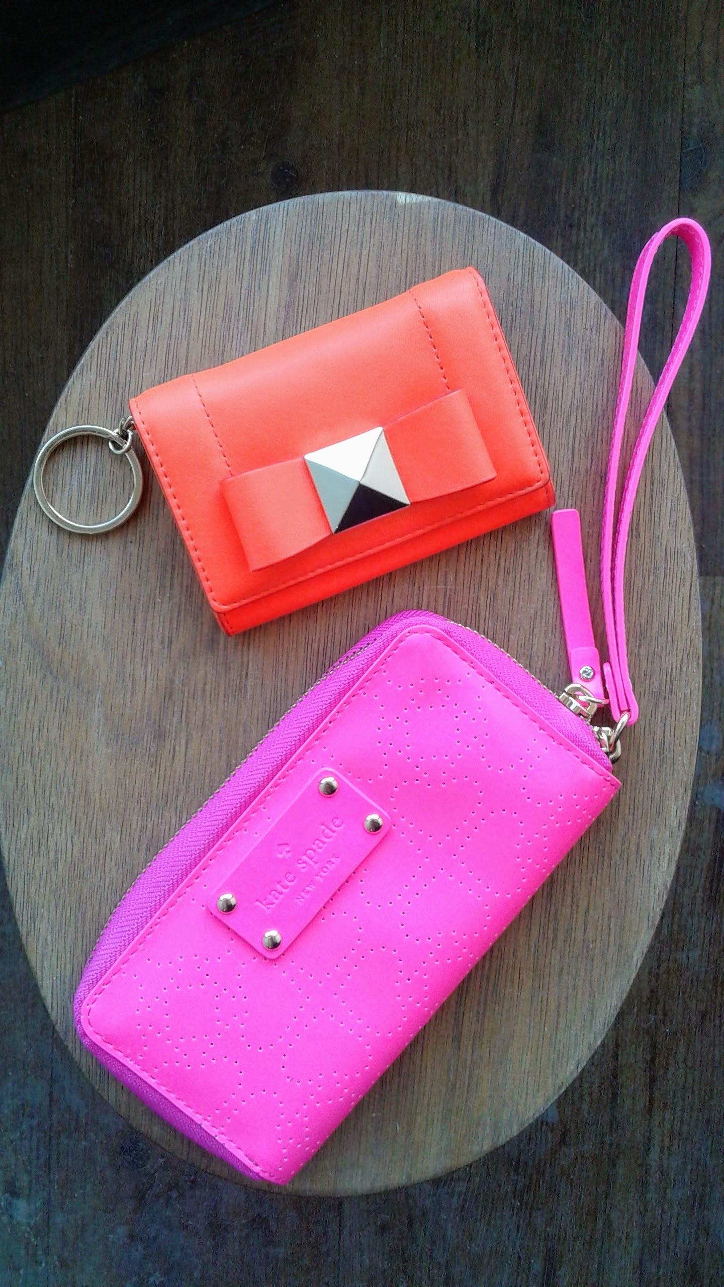 Orange Kate Spade wallet, $43. Pink Kate Spade wristlet, $46