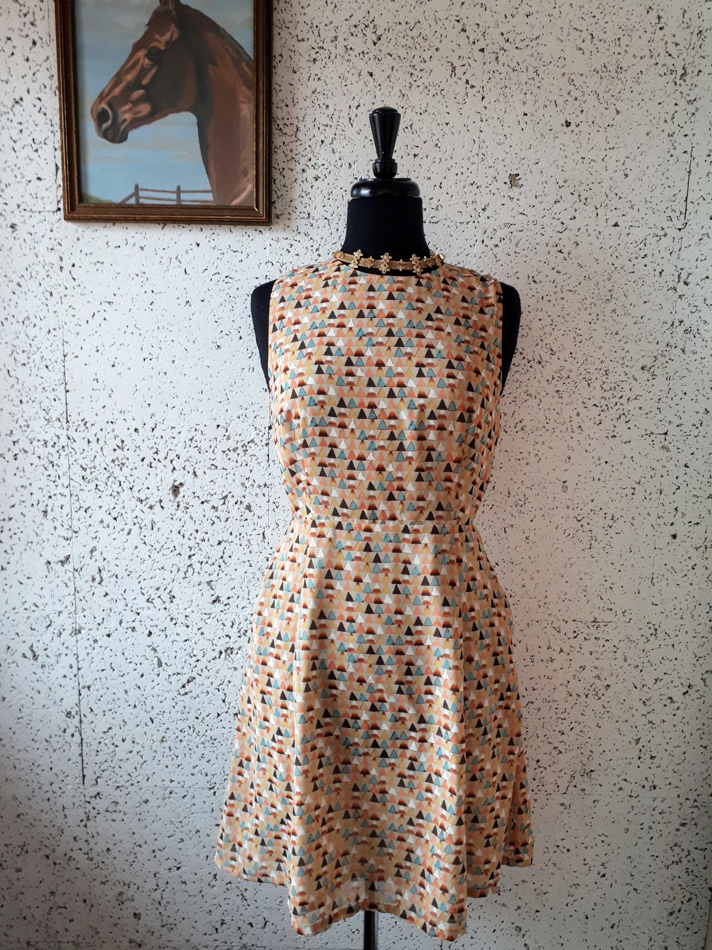 Loft 82 dress; Size S, $38. Necklace, $22.