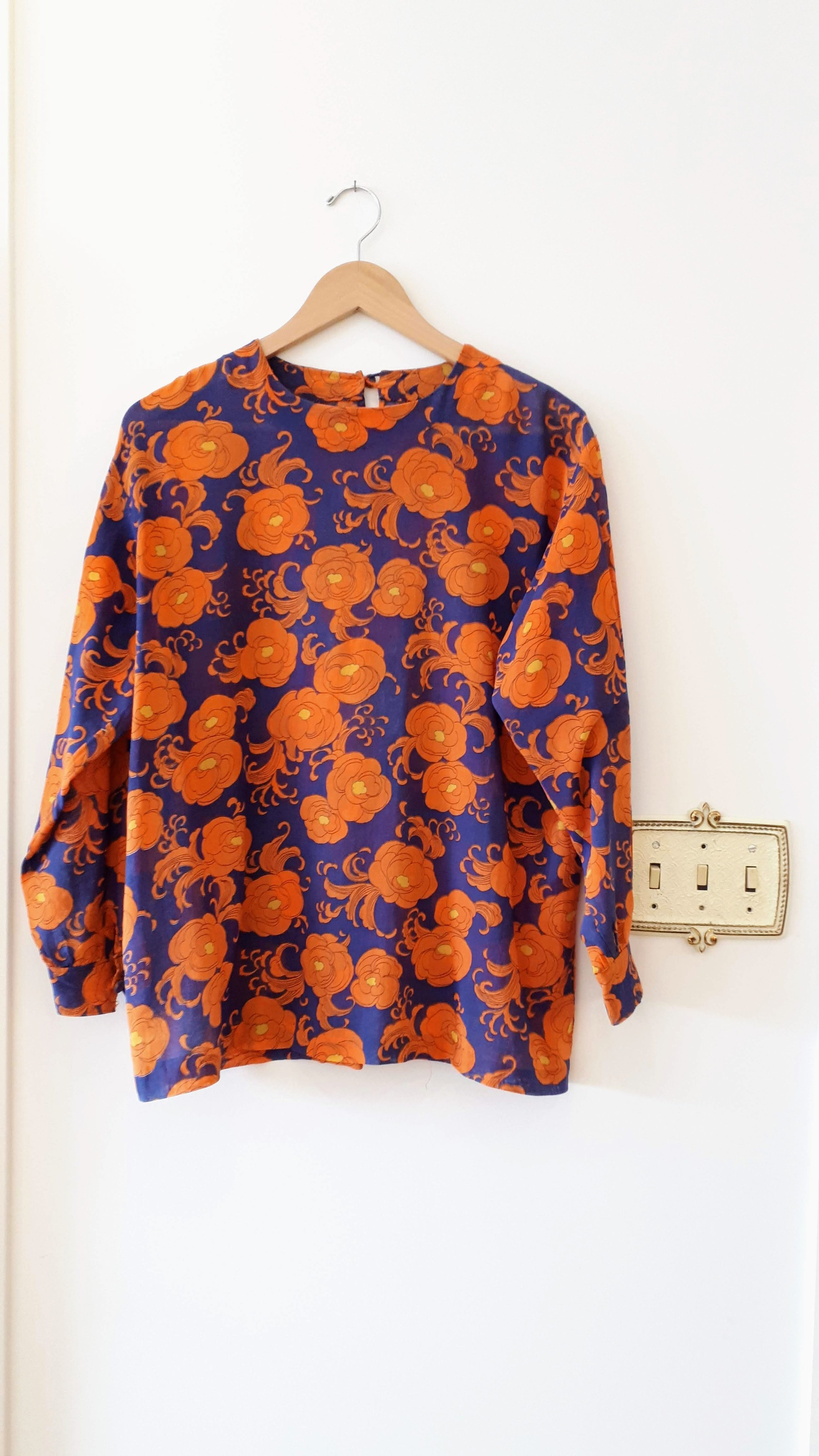 Blue and orange top; Size M, $26