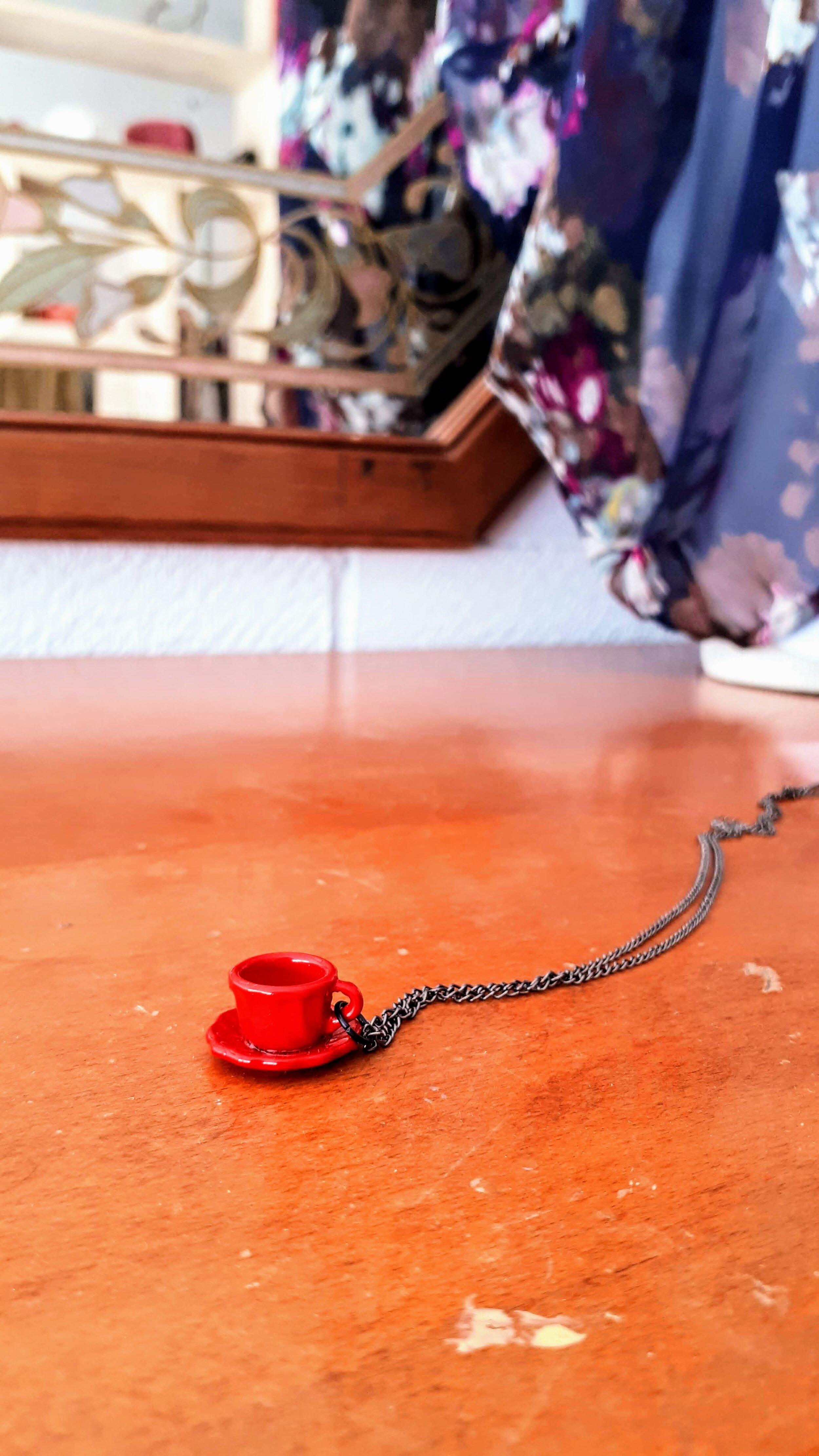 Tea cup necklace, $16