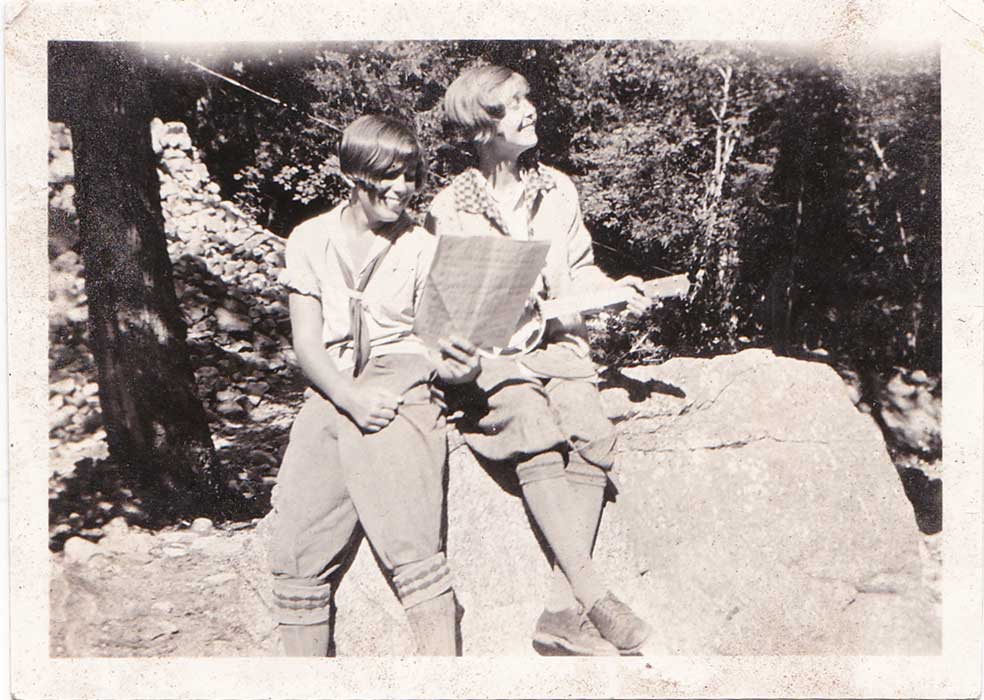 "Mandy's Grandma Ethel Olson (right) and her friend Ruth. Ethel is playing a banjo uke that now gets much love and attention from grand and great-granddaughters. The back of the photo says ""Ice House Canyon Methodist Cabin about 1925"". Two years later she'd go on that fourth of July date mentioned in ""Arlene and the Fourth of July""."