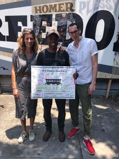 Erin and Jon with Cey at the mural unveiling, with thank you card from Plessy students, May 15, 2018.