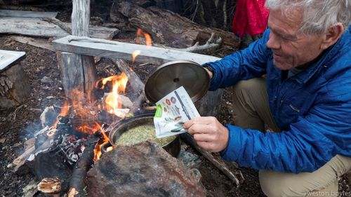 "Rick makes dinner with the new Patagonia Provisions Tsampa Soupal, though for him it was ""not so new"" because he's been eating tsampa with Yvon on their climbing trips going back nearly 40 years. Photo: Weston Boyles"
