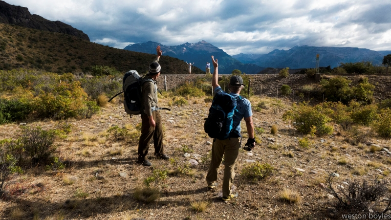 Jib Ellison (left) and Rick Ridgeway (right) wave goodbye to Kris Tompkins, former CEO of Patagonia and founder of Conservacion Patagonica, at the start of the hike. Photo:  Weston Boyles
