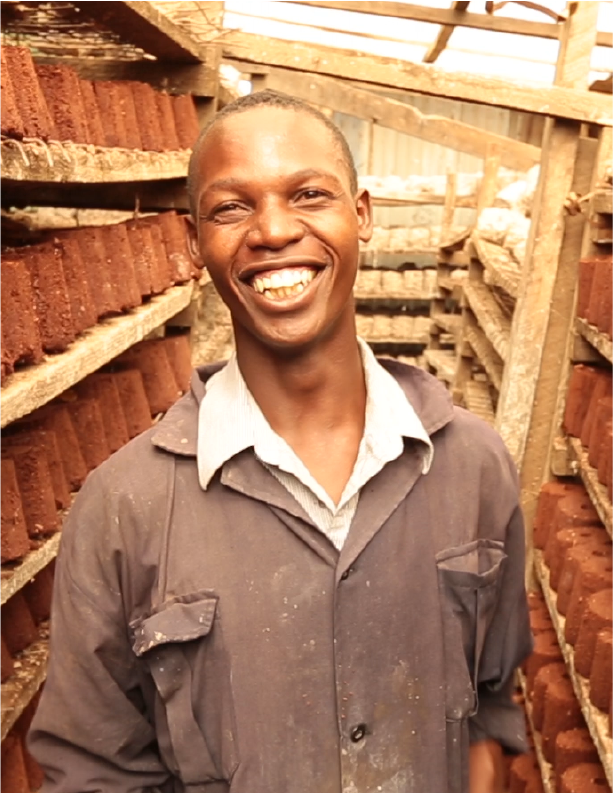 "Joseph Ndinya, financial manager of Kenya-based White Charcoal, salvages paper from Nairobi trash dumps and compresses it into briquettes, an alternative to wood-based home-heating fuel. Using earnings from his company, Joseph was able to buy his mother a house, an impossibility just a few years earlier.  Joseph credits JA with his business acumen: ""If not for the JA training and White Charcoal business, I would be jobless, and I don't know if I would be alive."""