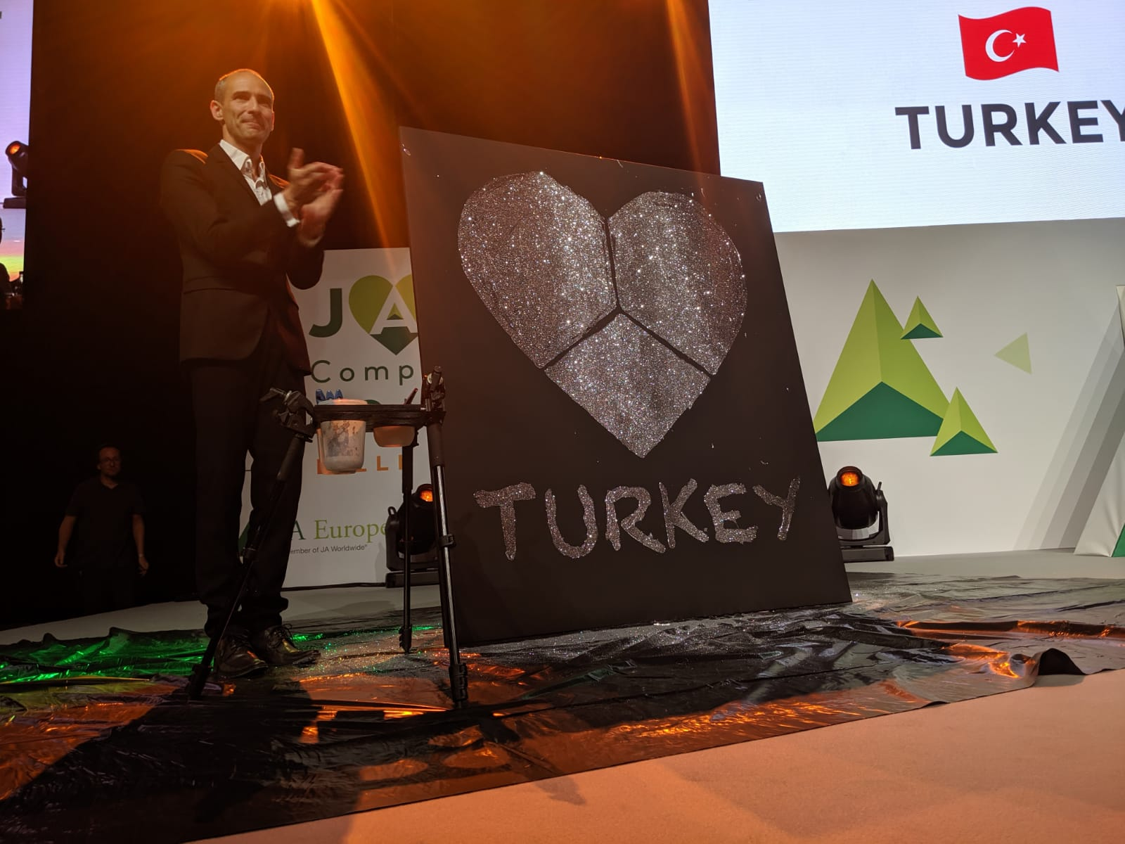 Artist's design to reveal the 2019 Company of the Year winner—Turkey.