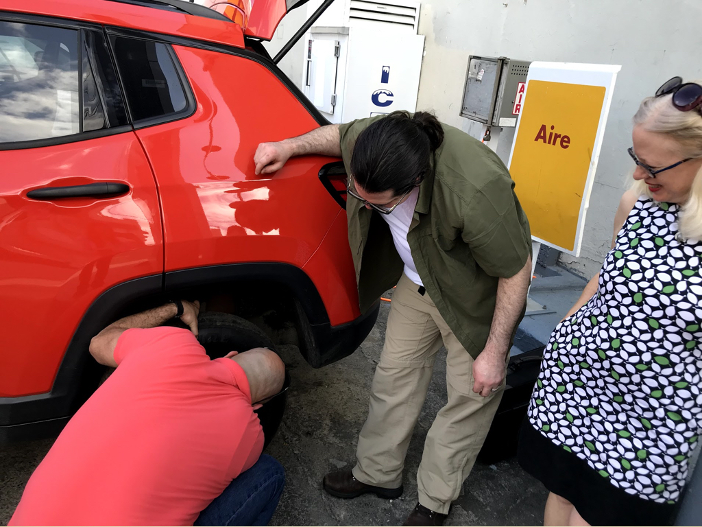 Margaret & Crystal navigated the rental car company and exchange. Amaury & Stephen changed the tire. And Leslie provided general knowledge and support to both. What a team!
