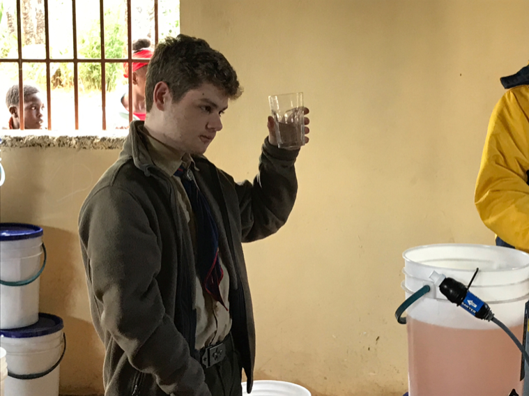 Jack readies to drink what was formerly muddy water.