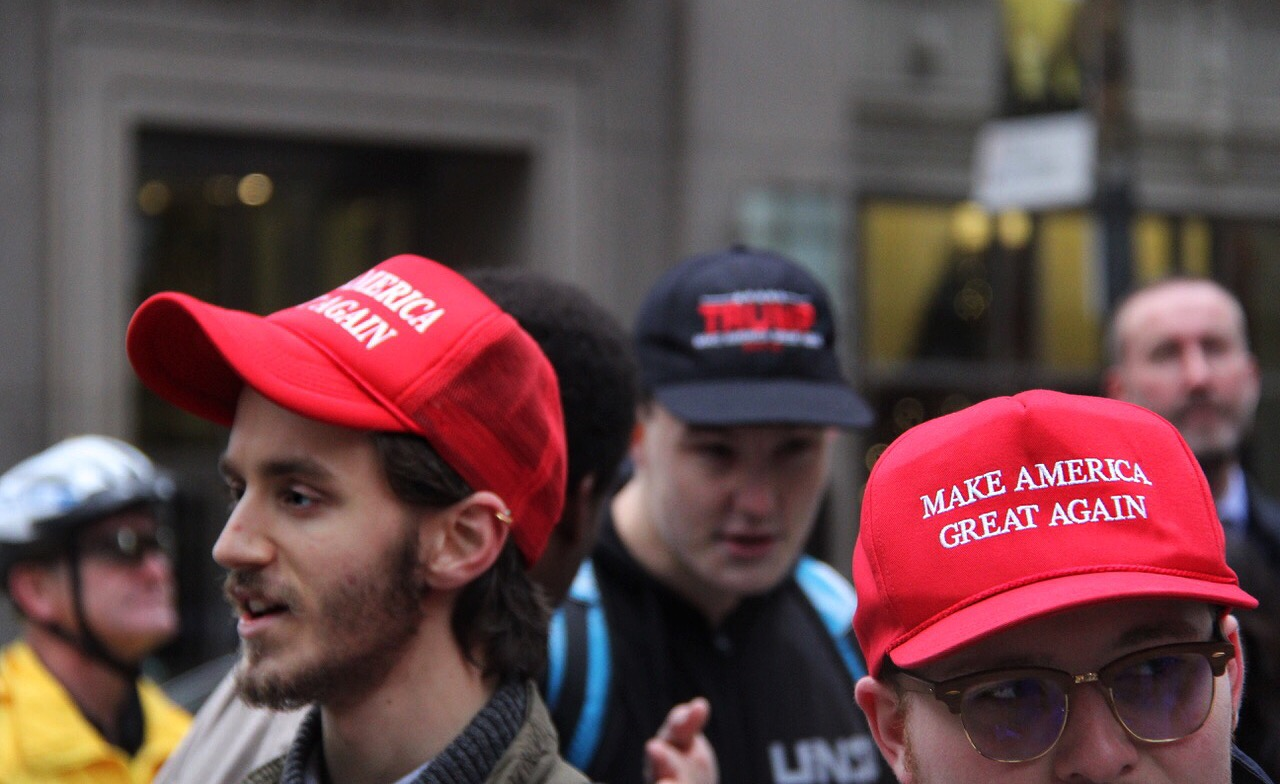 A small group of Trump supporters were among the sea of Anti-Trump protestors on Saturday, with some sporting Trump's iconic red hat.