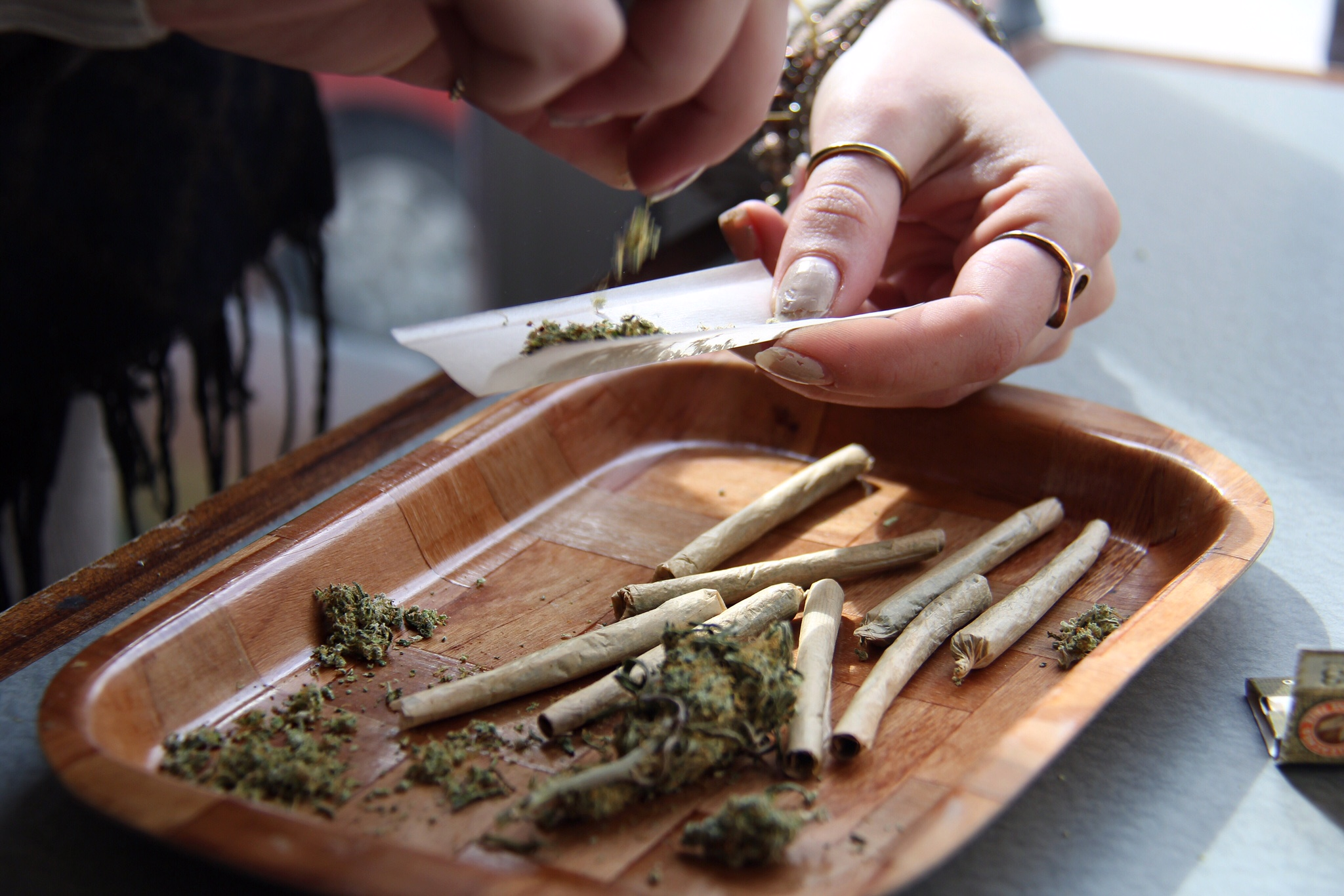 An employee at Cannabis Culture's Church Street location, prepares a joint on Mar. 8, 2017.