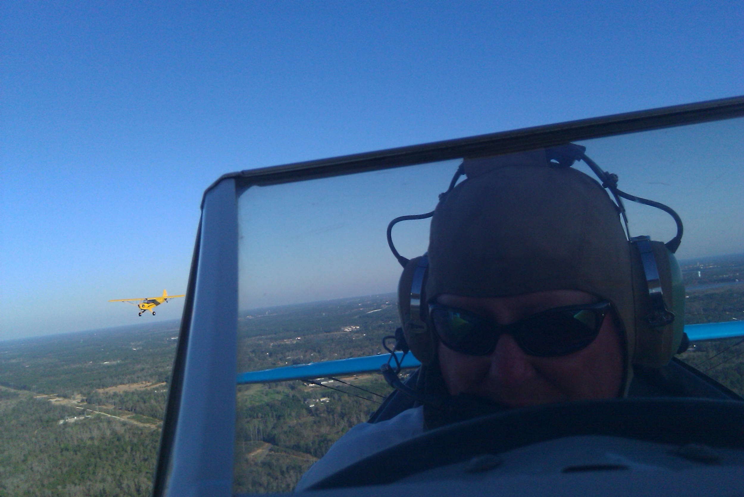Danny in Stearman with Cub following.jpg