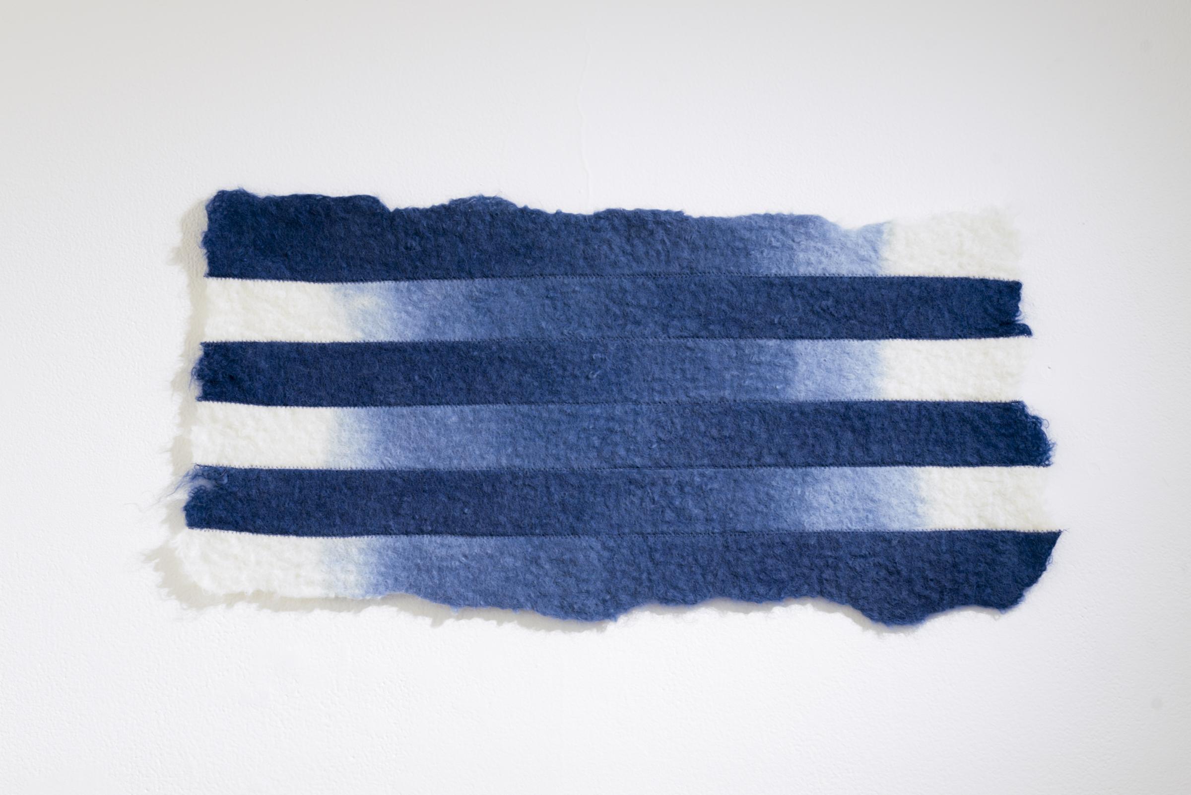 Dip, Snip and Flip, 2016, wet felted Romney-Tisdale sheep fleece, thread, and indigo dye, 32 x 64cm.